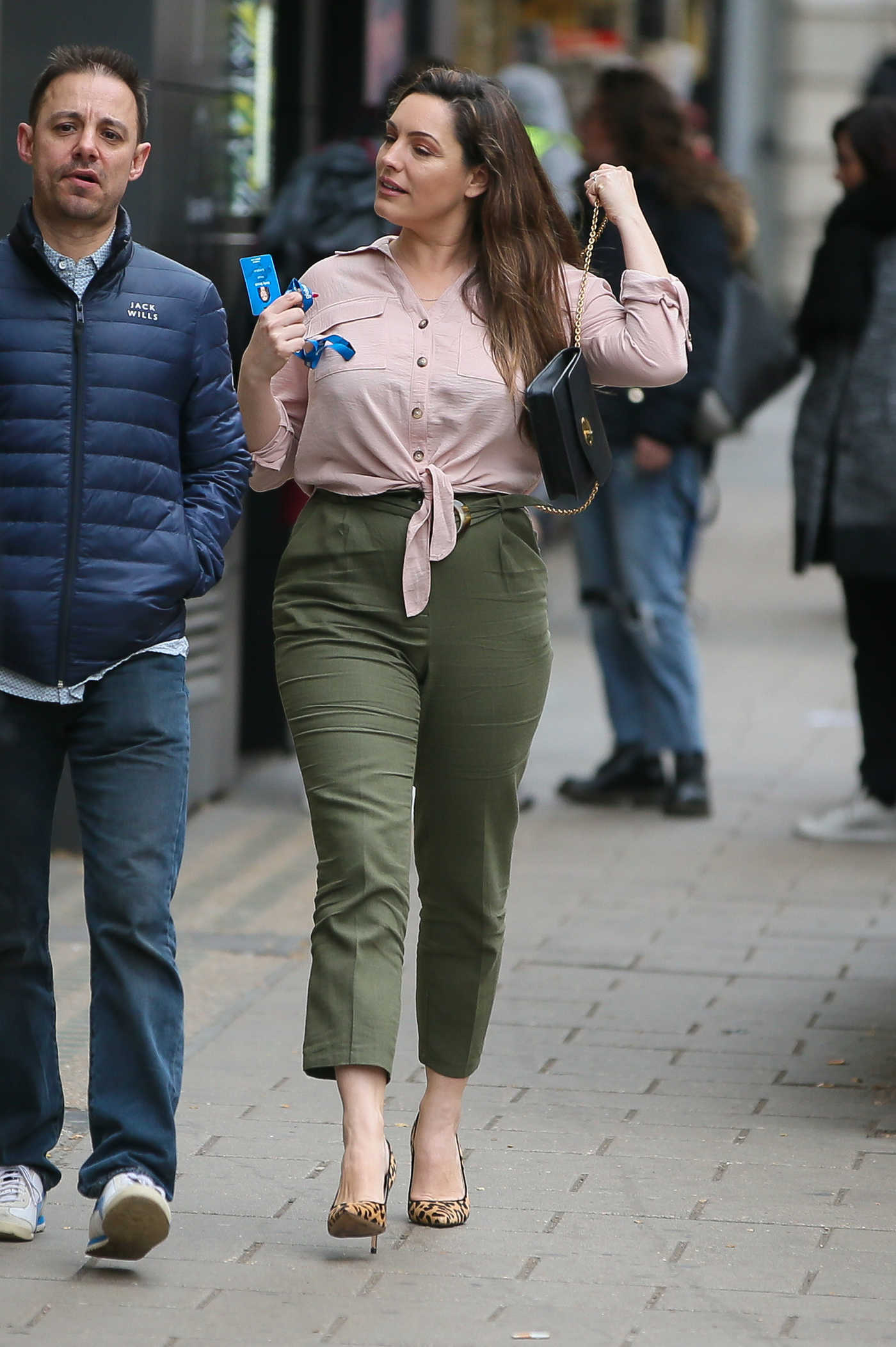 Kelly Brook in a Green Pants Arrives at Global Radio Studios in London 03/22/2019