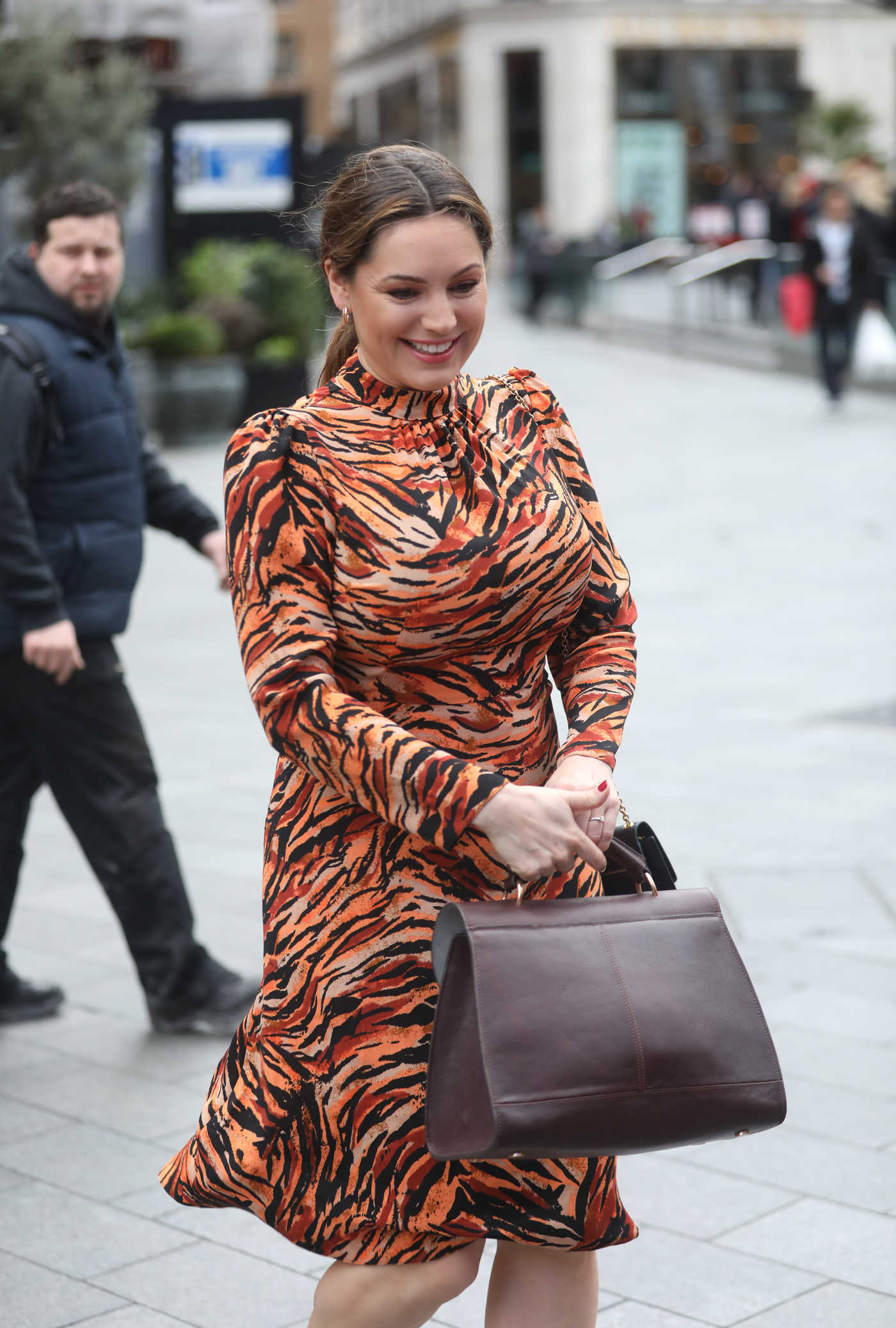 Kelly Brook in a Leopard Print Dress Arrives at Global Radio Studios in London 03/15/2019