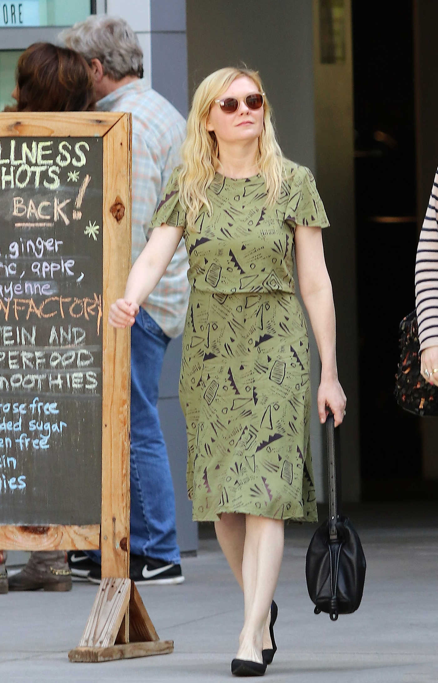 Kirsten Dunst in a Green Dress Was Seen Out with a Friend in Los Angeles 03/24/2019