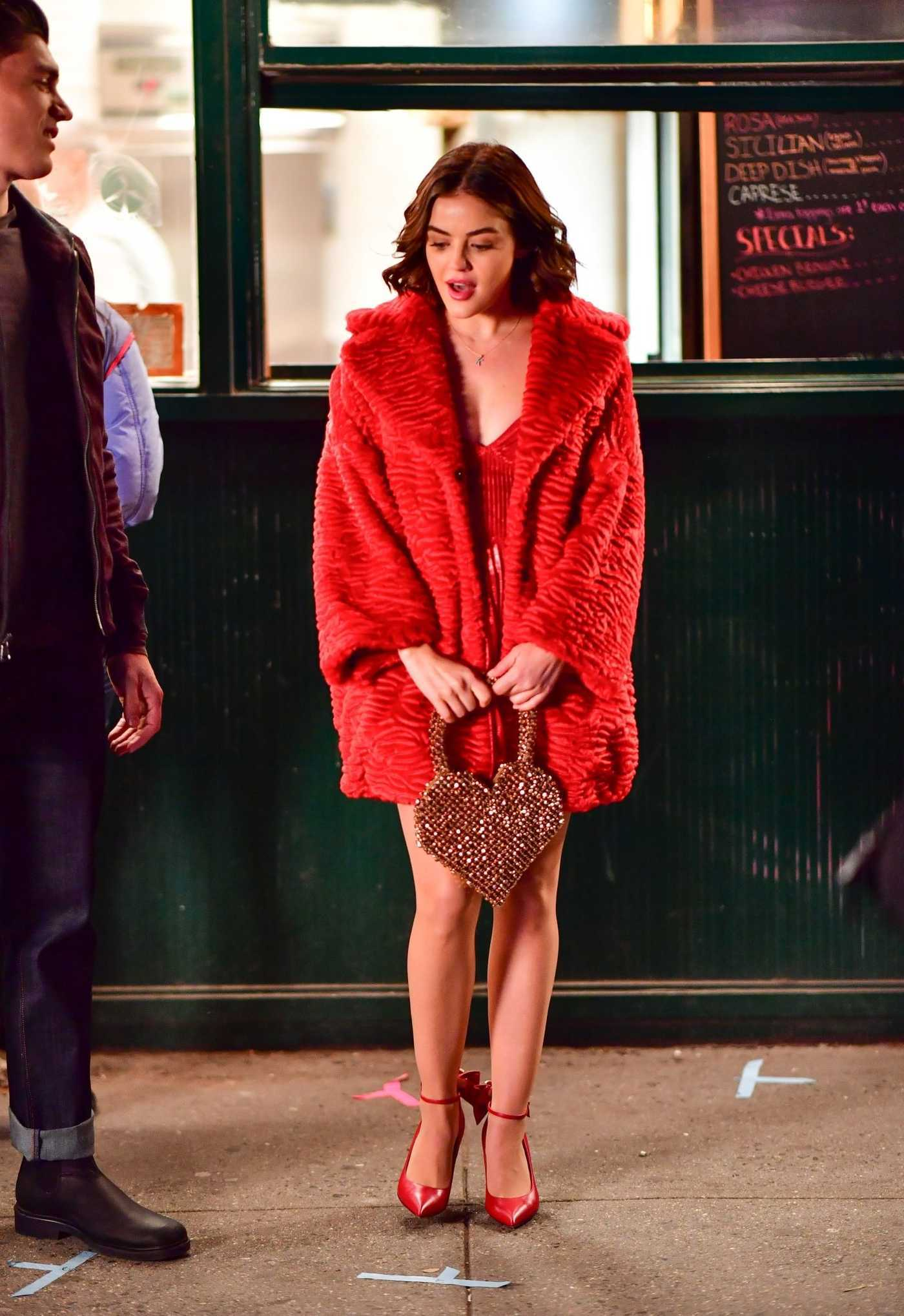 Lucy Hale in a Red Coat on Set of the Katy Keene in NYC 03/23/2019