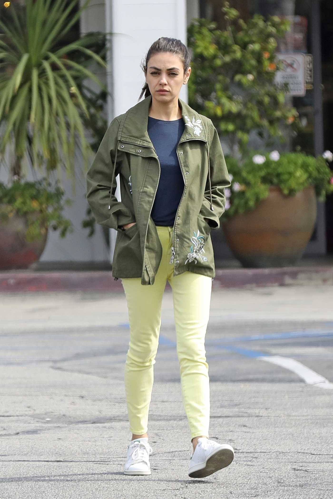 Mila Kunis in a Green Windbreaker Was Seen Out in LA 03/24/2019