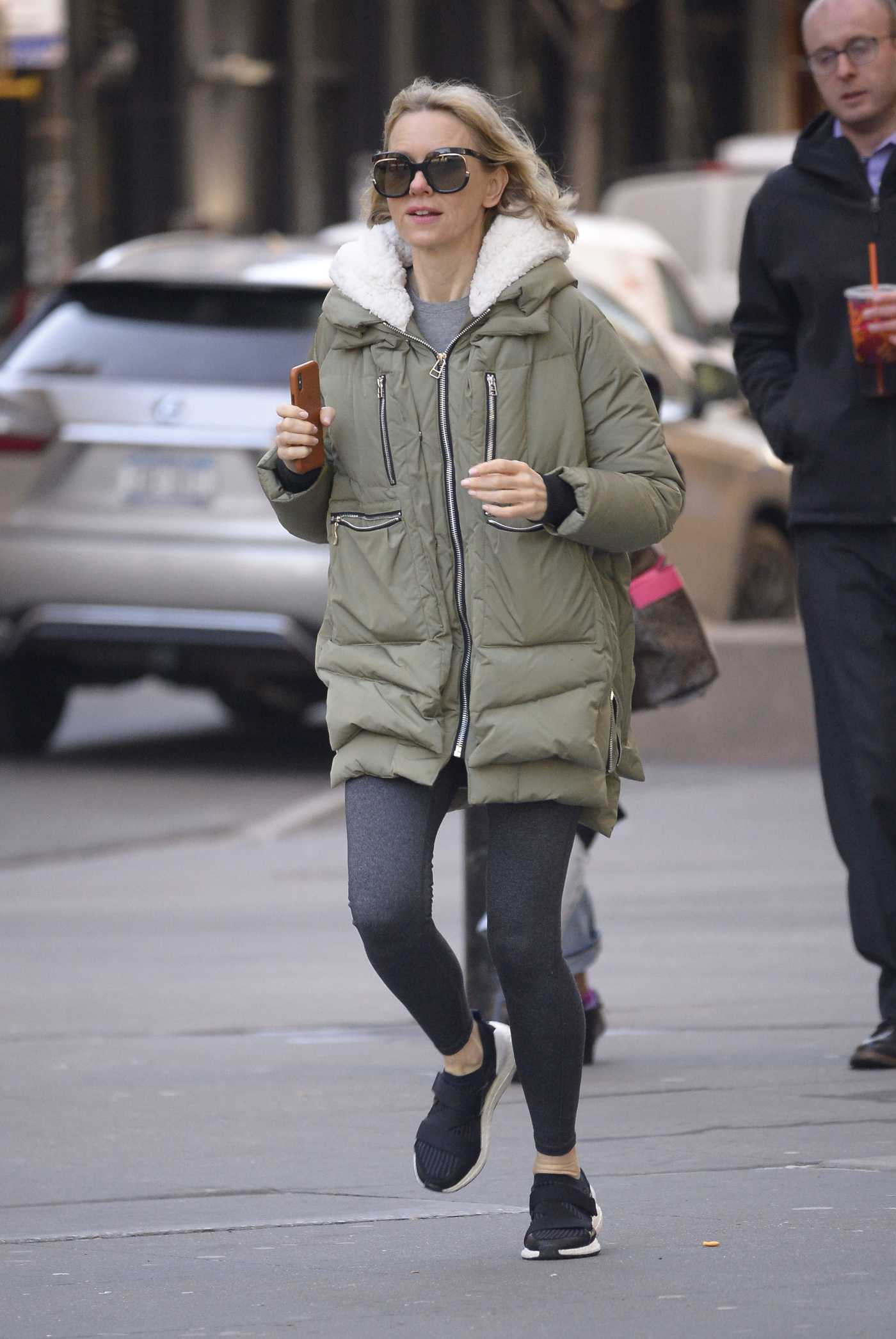 Naomi Watts in a Beige Puffer Jacket Running Back Home in NYC 03/28/2019