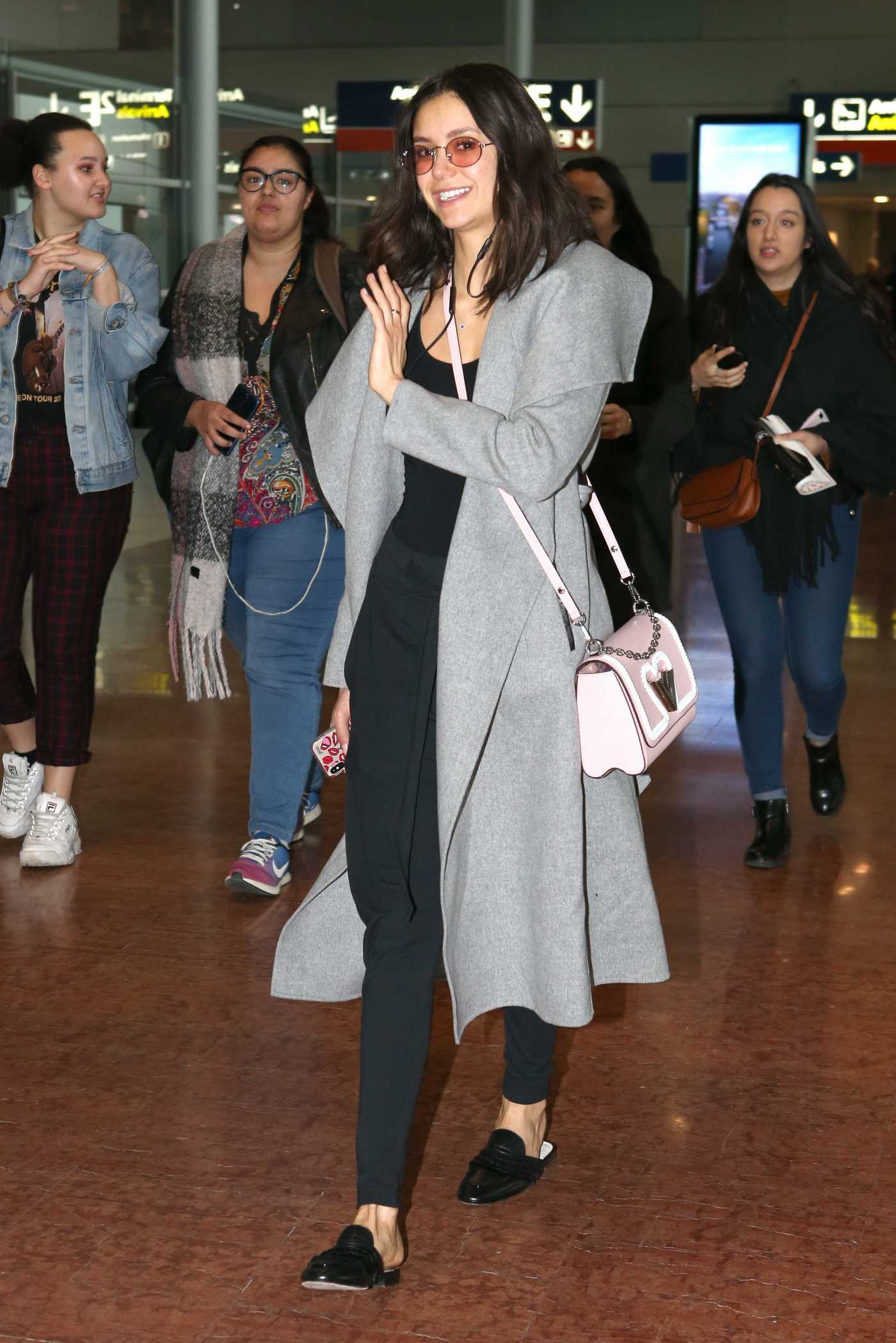 Nina Dobrev in a Gray Coat Arrives at CDG Airport in Paris 03/02/2019