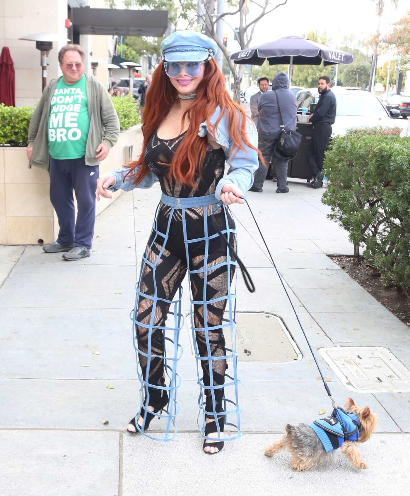 Phoebe Price in a Blue Cap Walks Her Dog Out in Beverly Hills 03/01/2019