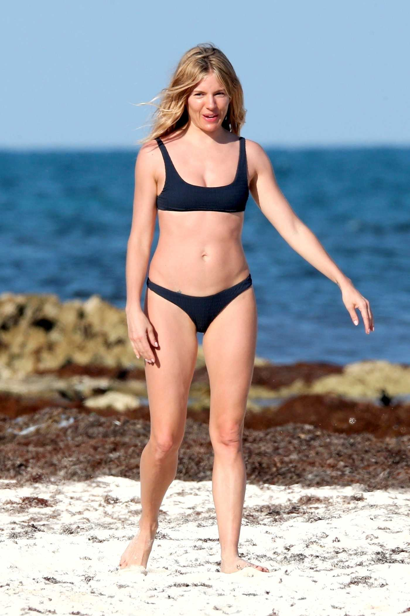 Sienna Miller in a Black Bikini on the Beach in Tulum, Mexico 03/20/2019