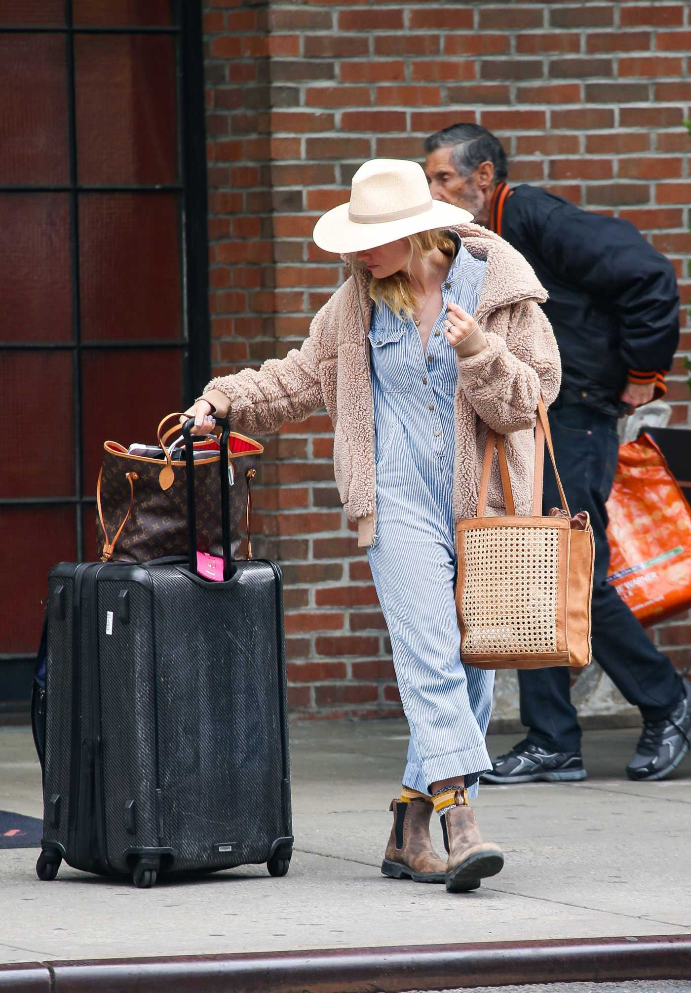 Beth Behrs in a Beige Hat Leaves Her Hotel in NYC 04/21/2019