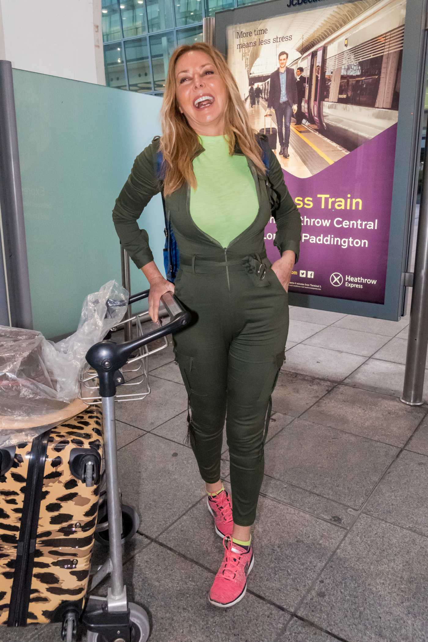 Carol Vorderman in a Green Overalls Arrives at Heathrow Airport in London 04/02/2019
