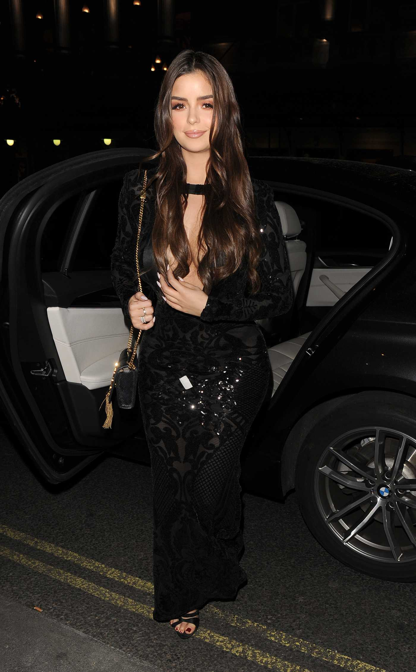 Demi Rose in a Black Dress Arrives for A Dinner in Mayfair, London 04/24/2019