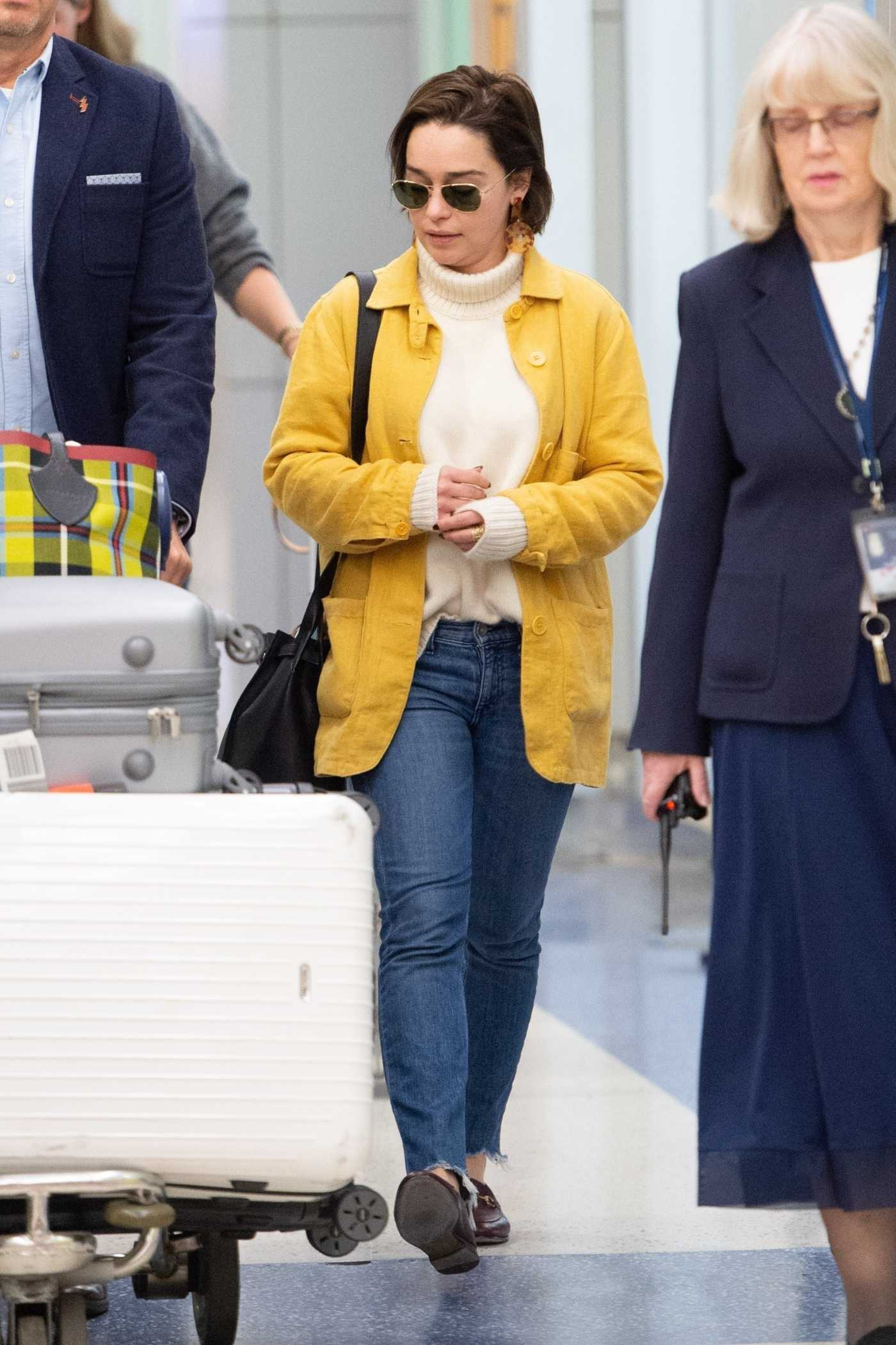 Emilia Clarke in a Yellow Blazer Arrives at JFK Airport in New York 03/30/2019