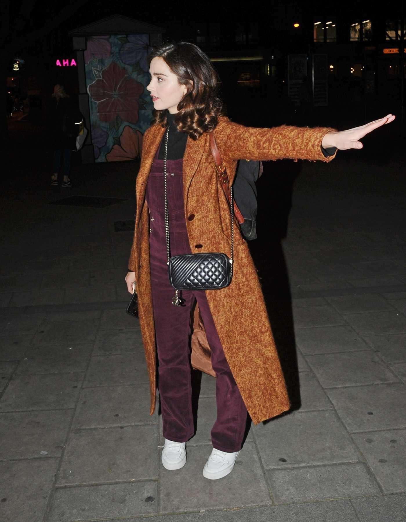 Jenna Coleman in an Orange Coat Leaves the Old Vic Theatre in London 04/20/2019