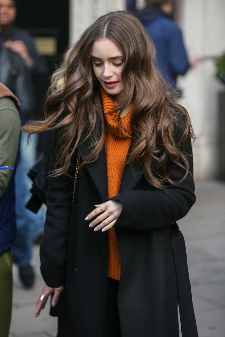 Lily Collins in an Orange Sweater