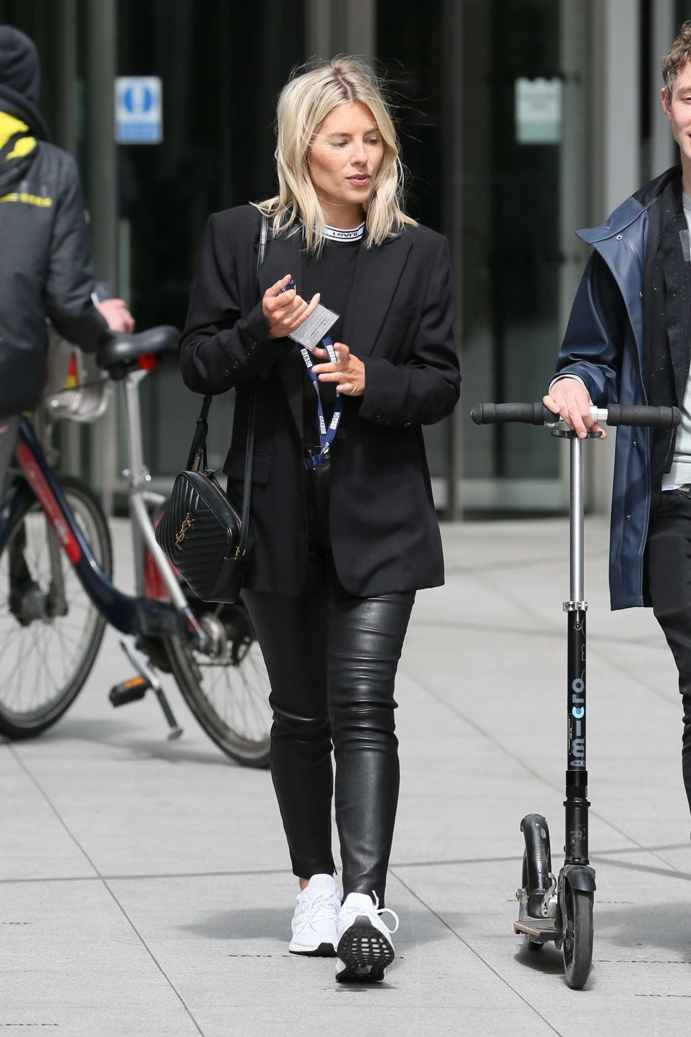 Mollie King in a Black Blazer Arrives at BBC Radio 1 Studios in London 04/24/2019