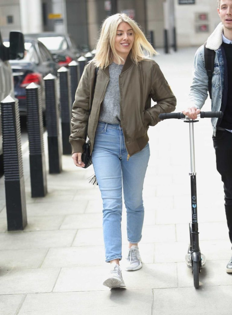 Mollie King in an Olive Bomber Jacket
