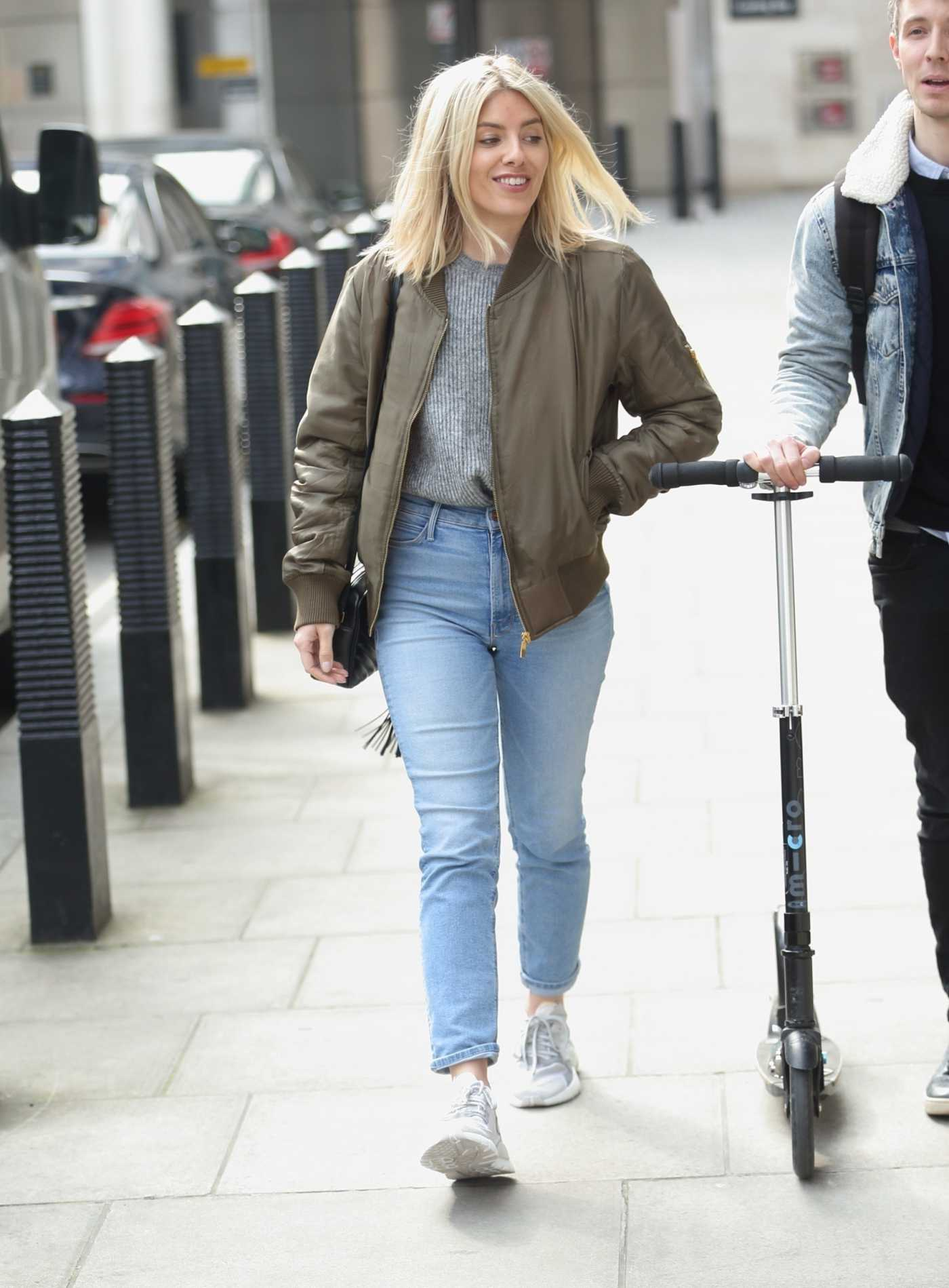 Mollie King in an Olive Bomber Jacket Arrives at BBC Studio in London 04/13/2019