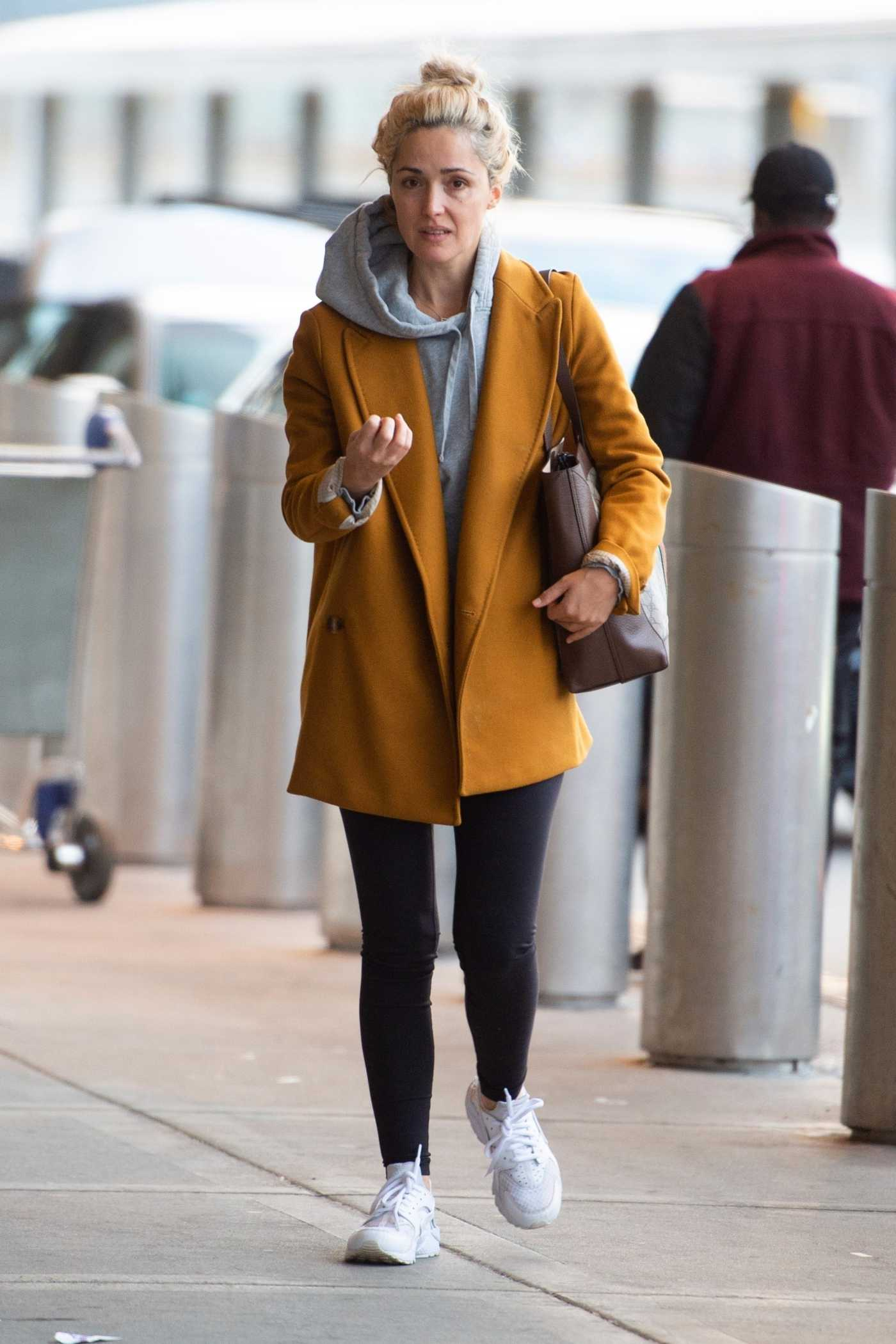 Rose Byrne in a Yellow Coat Arrives at JFK Airport in NYC 03/30/2019