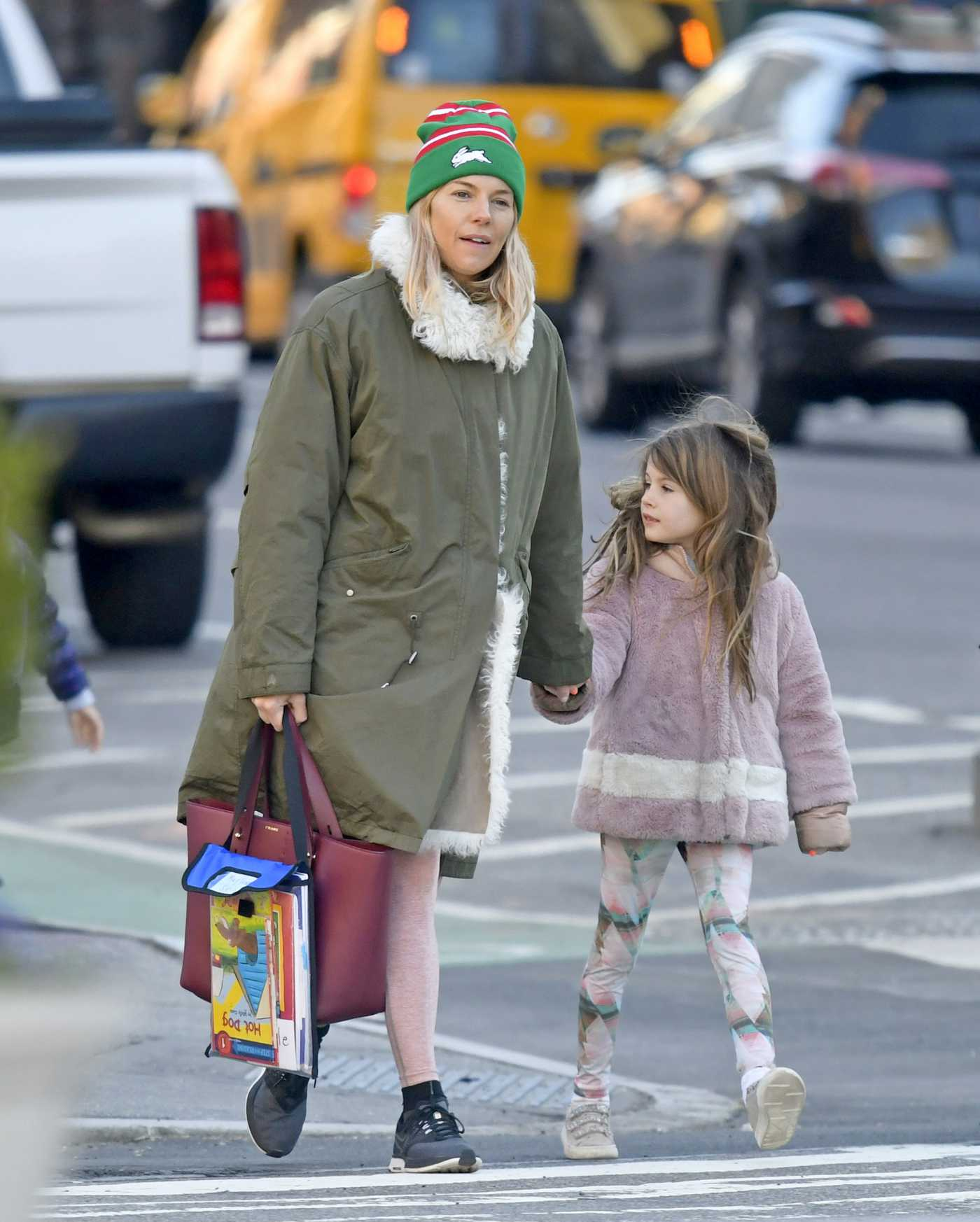Sienna Miller in a Green Knit Hat Was Seen Out with Her Daughter in New York 04/01/2019