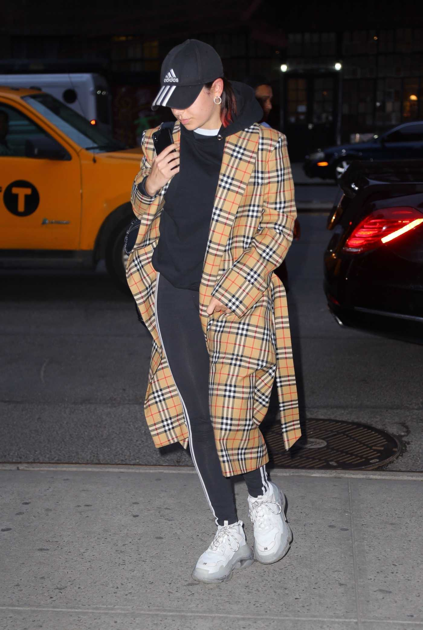 Charli XCX in a Plaid Trench Coat Arrives at the Bowery Hotel in New York City 04/29/2019