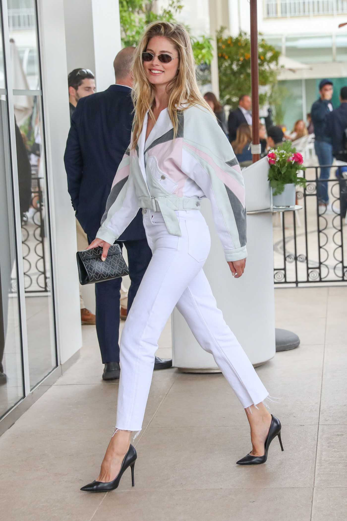 Doutzen Kroes in a White Jeans Arrives at the Martinez Hotel During the 72nd Annual Cannes Film Festival in Cannes 05/21/2019