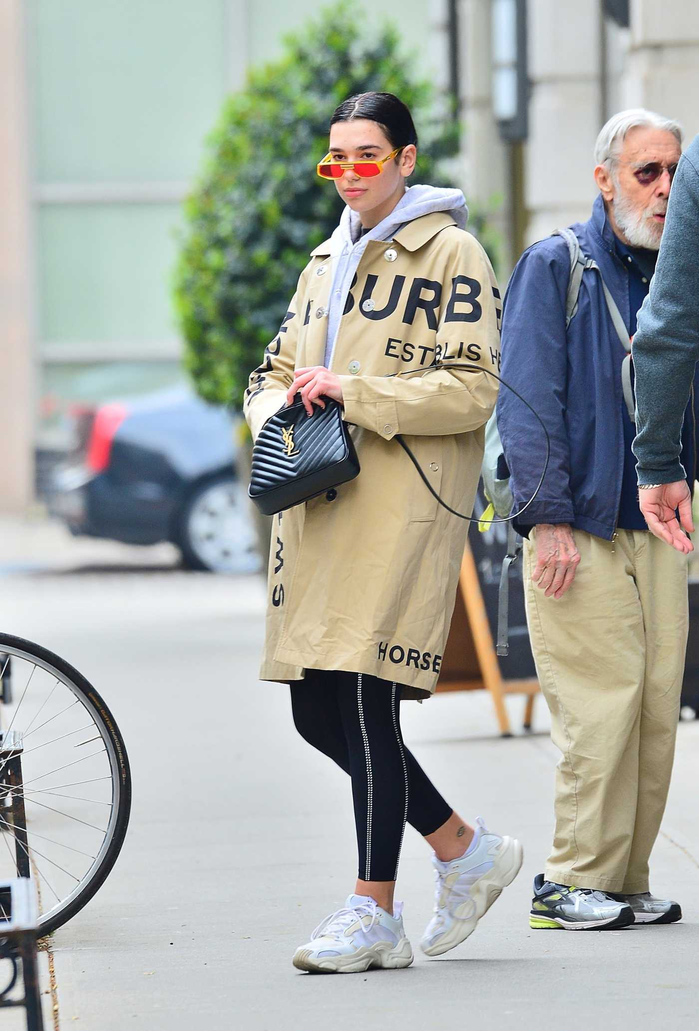 Dua Lipa in a Beige Trench Coat Leaves Gotham Gym in NYC 04/30/2019