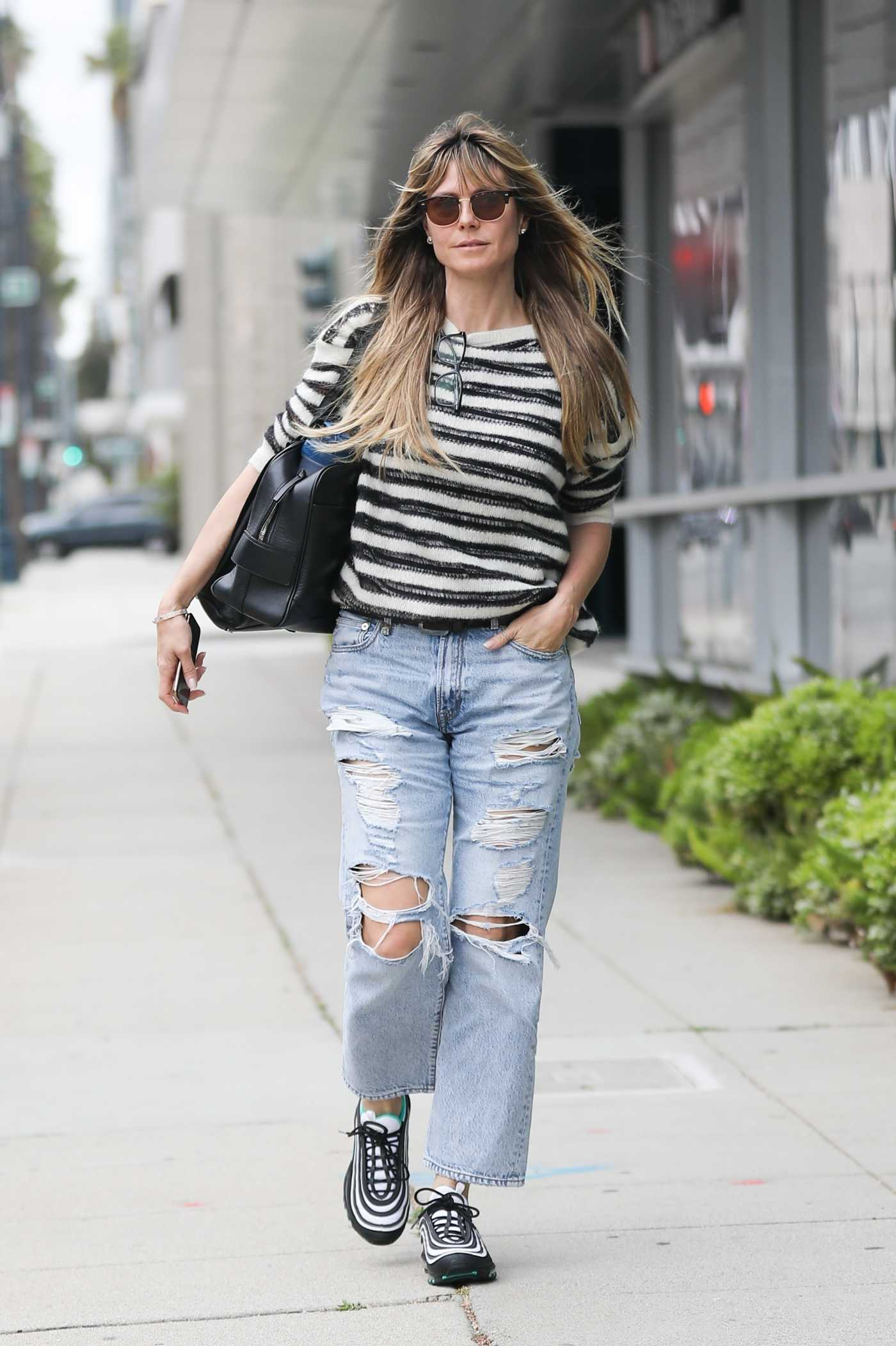 Heidi Klum in a Blue Ripped Jeans Heads to a Meeting in Beverly Hills 05/07/2019
