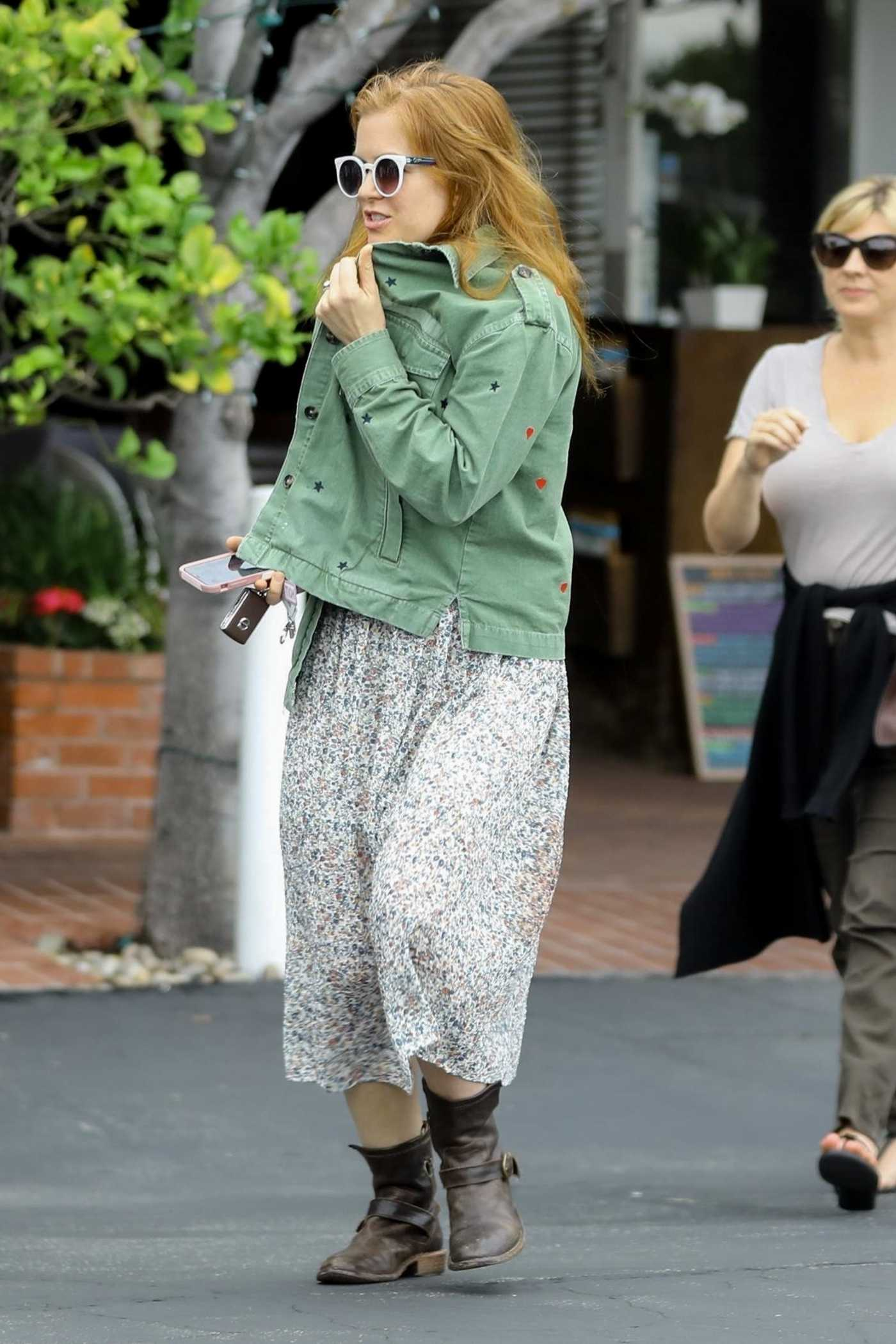 Isla Fisher in a Green Jacket Goes to Lunch with a Friend at Fred Segal Mauro's Restaurant in West Hollywood 05/09/2019