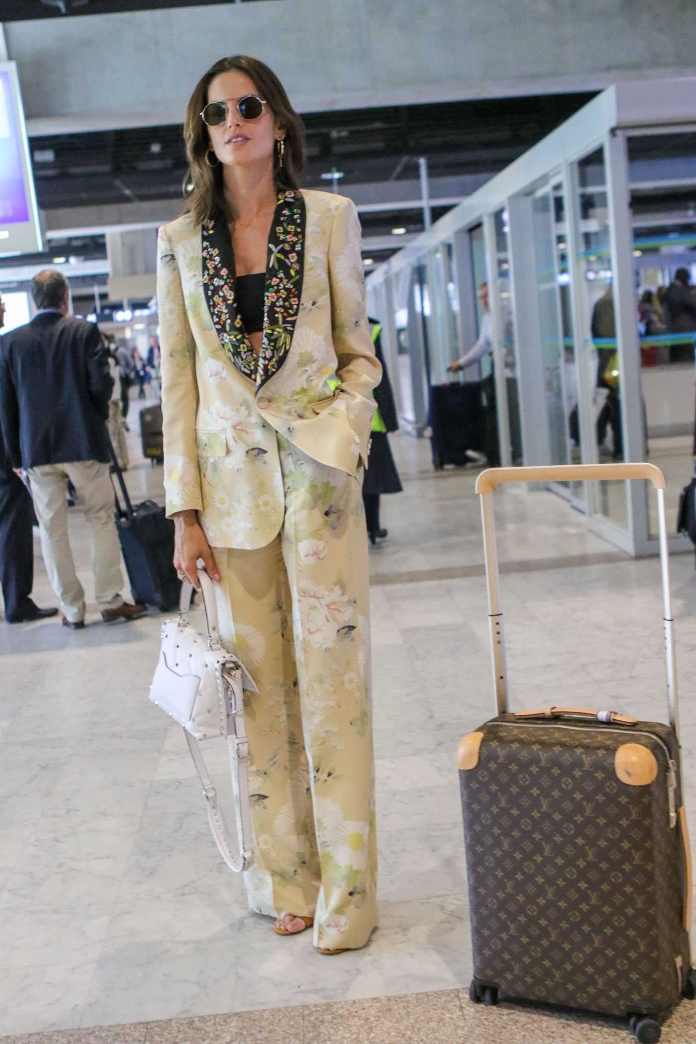 Izabel Goulart in a Beige Floral Suit Arrives at Nice Airport Ahead of the 72nd Annual Cannes Film Festival 05/13/2019