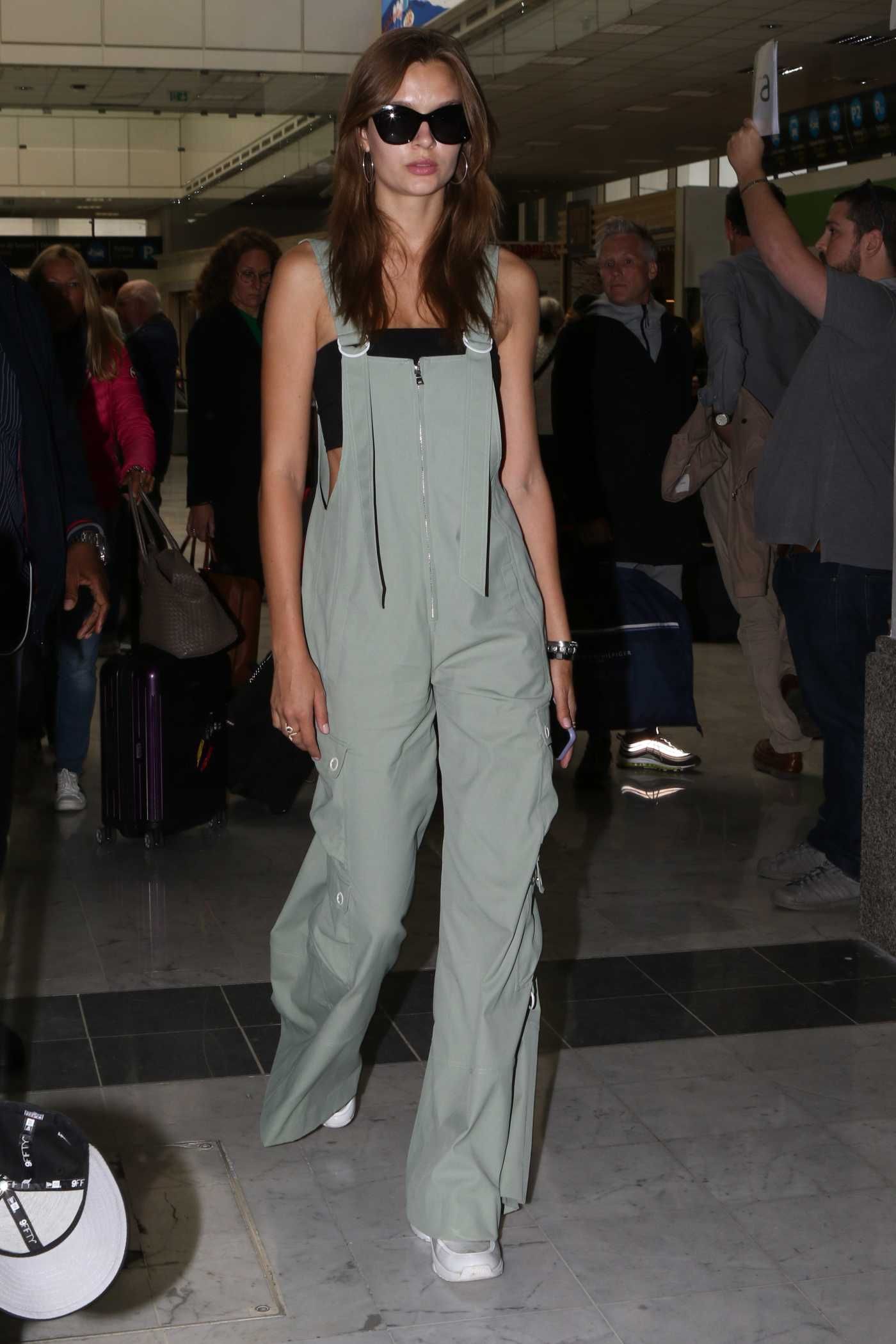 Josephine Skriver in a Green Jumpsuit Arrives at Nice Airport in Nice 05/18/2019