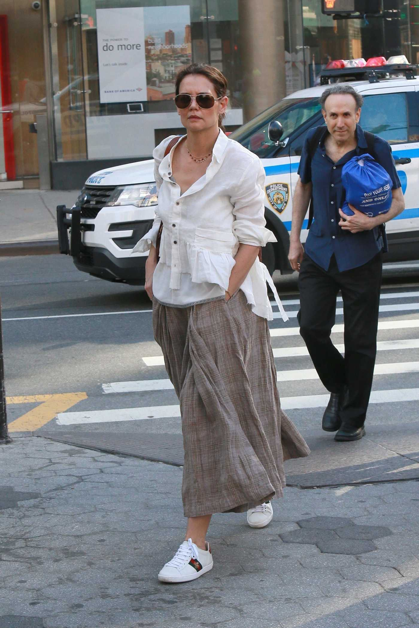 Katie Holmes in a White Blouse Heads into the Train Station in NYC 05/18/2019
