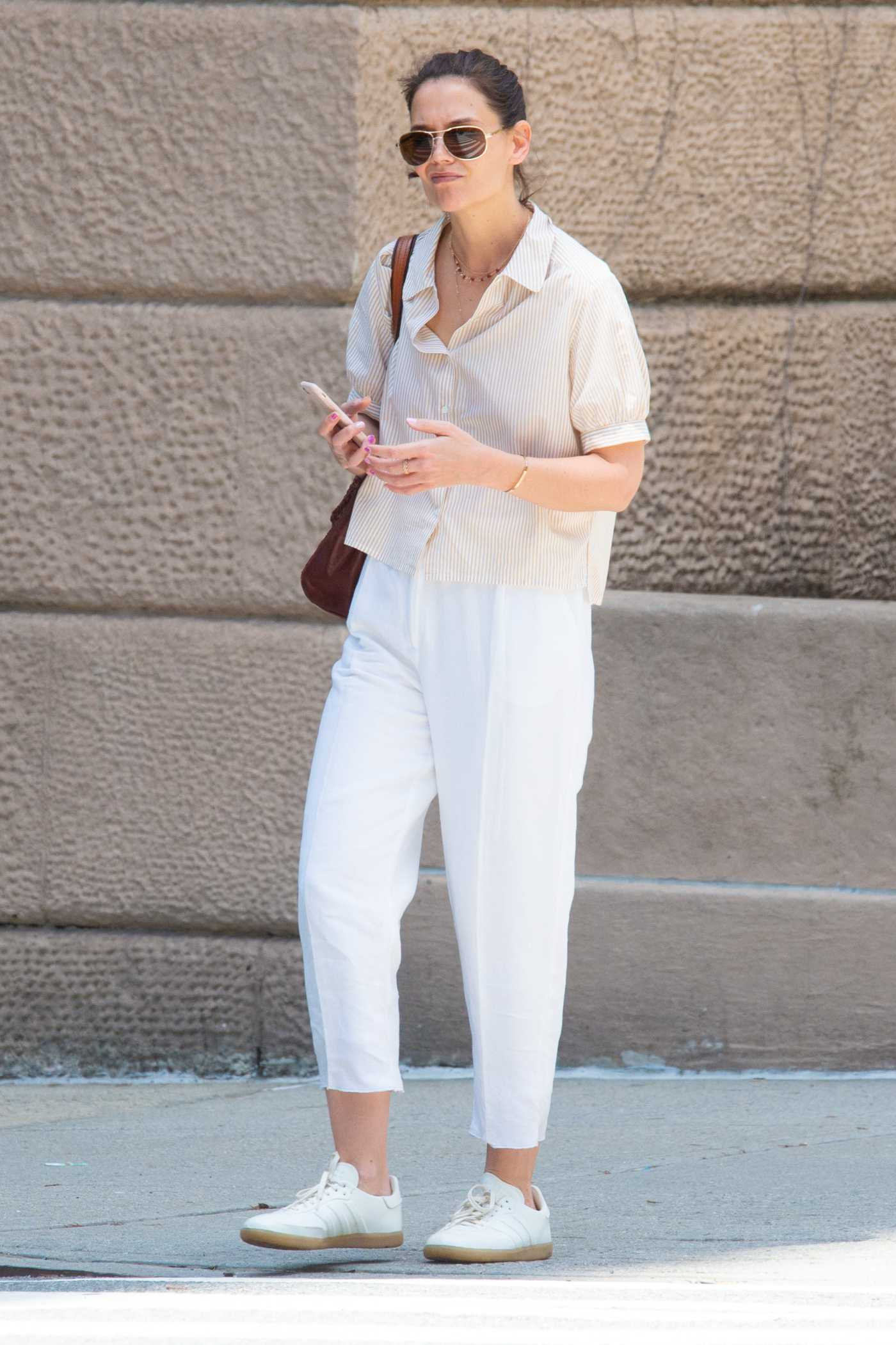 Katie Holmes in a White Pants Was Seen Out in NYC 05/15/2019