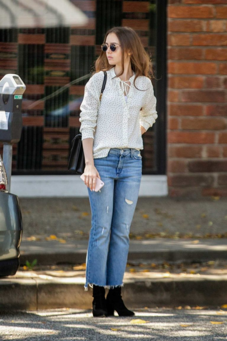 Lily Collins in a White Polka Dot Blouse