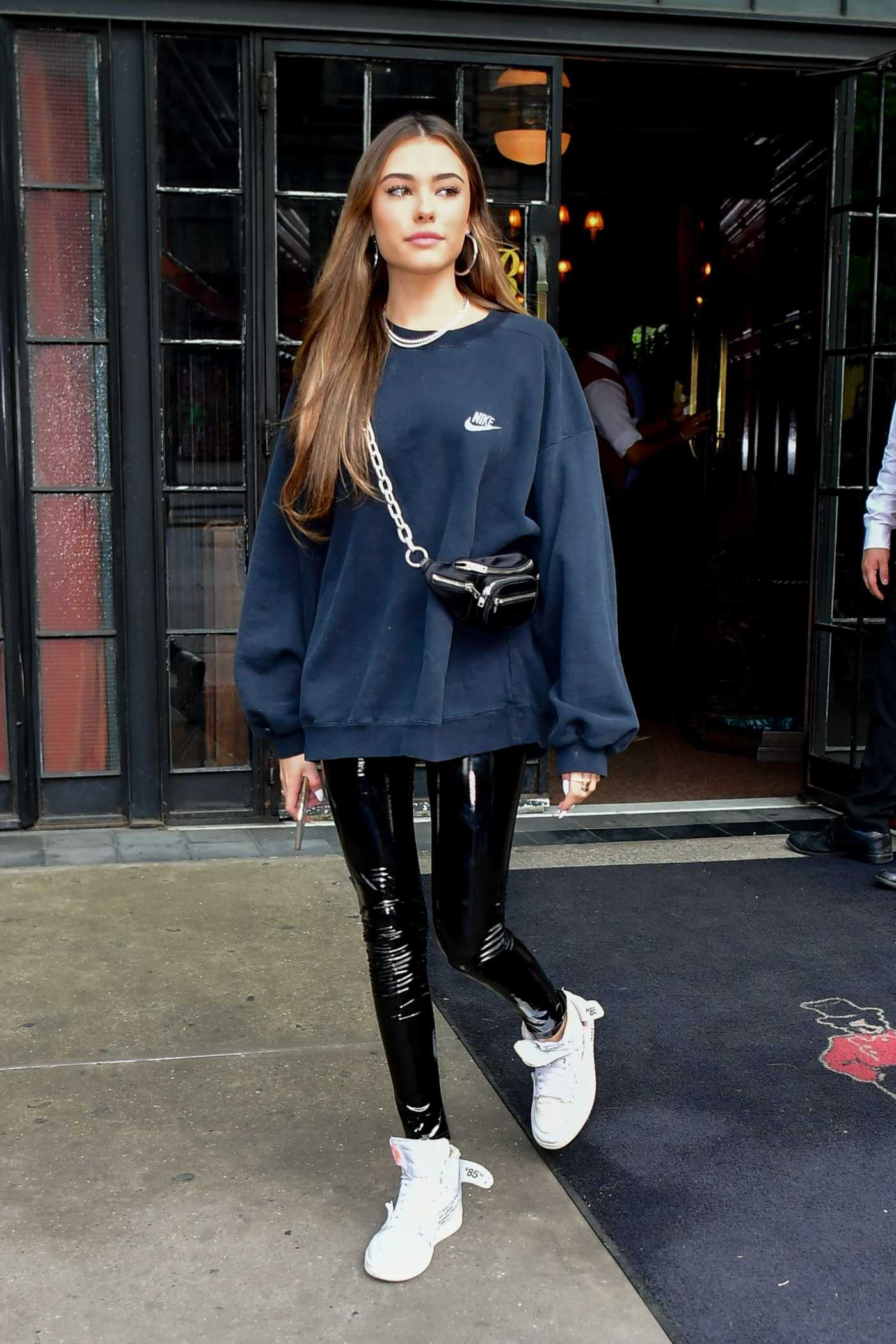 Madison Beer in a Black Oversized Nike Sweatshirt Leaves Her Hotel in NYC 05/10/2019