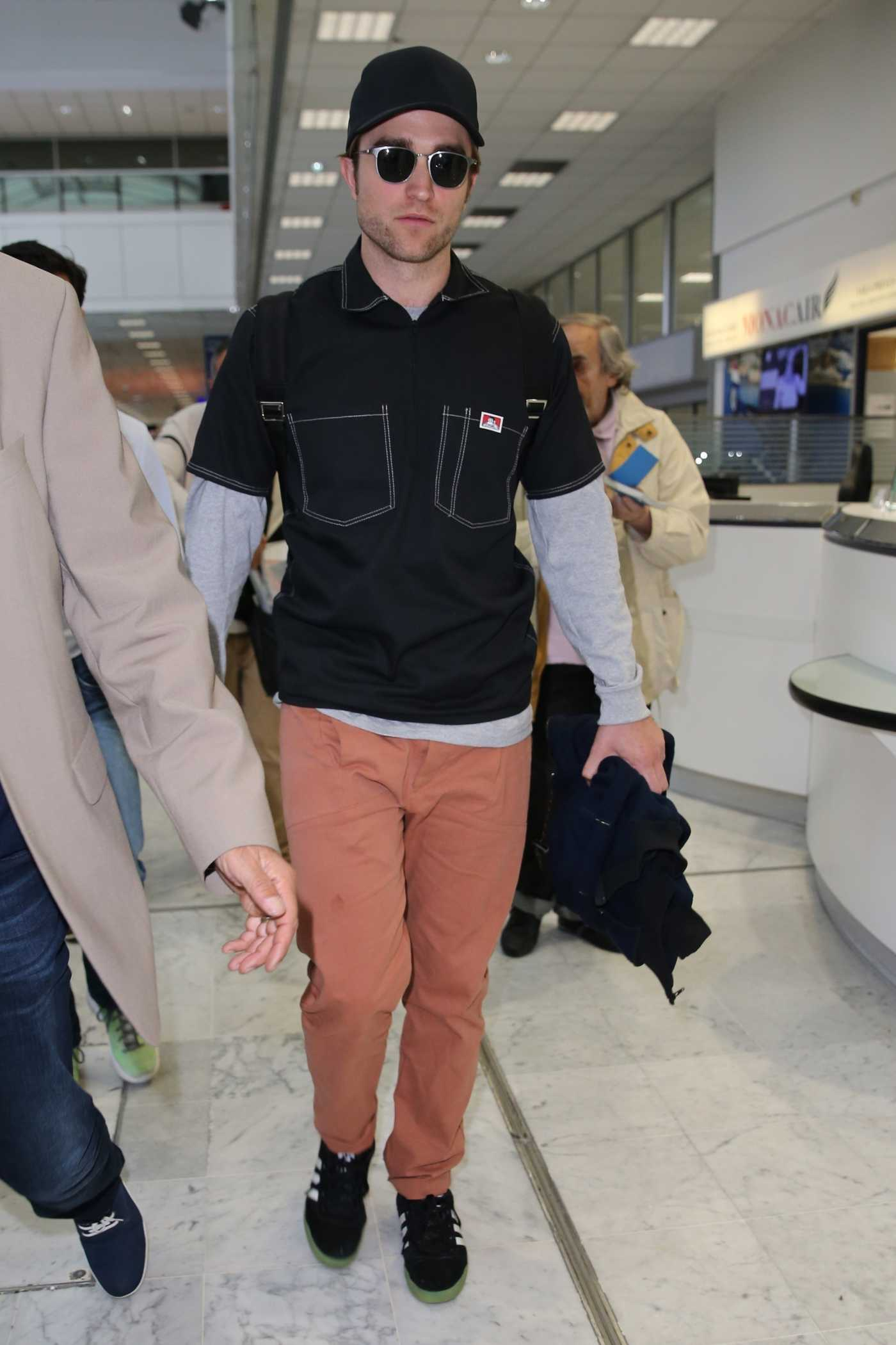 Robert Pattinson in a Black Cap Arrives at Nice Airport in Nice 05/17/2019