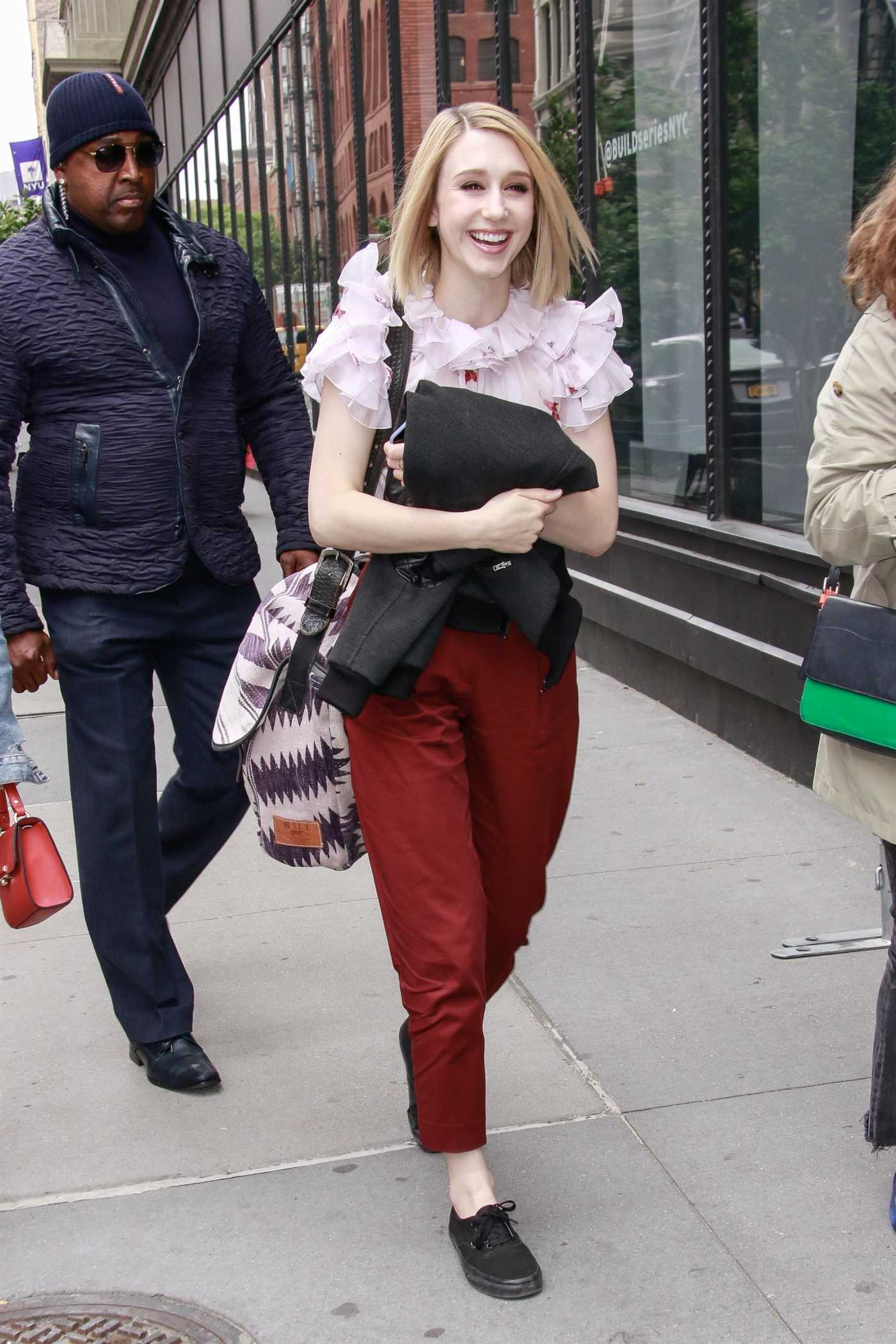 Taissa Farmiga in a Red Pants Arrives at the AOL Build Series in New York 05/09/2019
