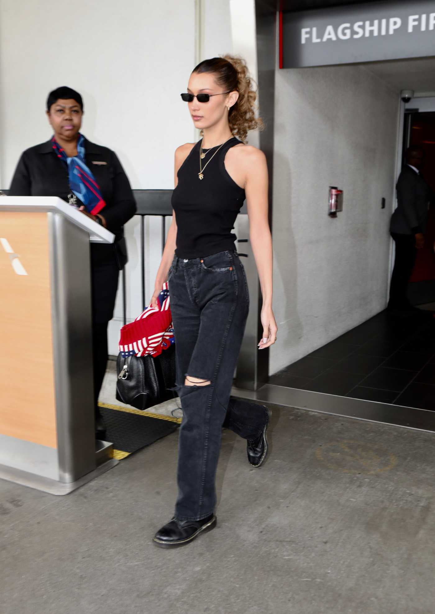 Bella Hadid in a Black Ripped Jeans Lands at LAX Airport in Los Angeles 06/04/2019