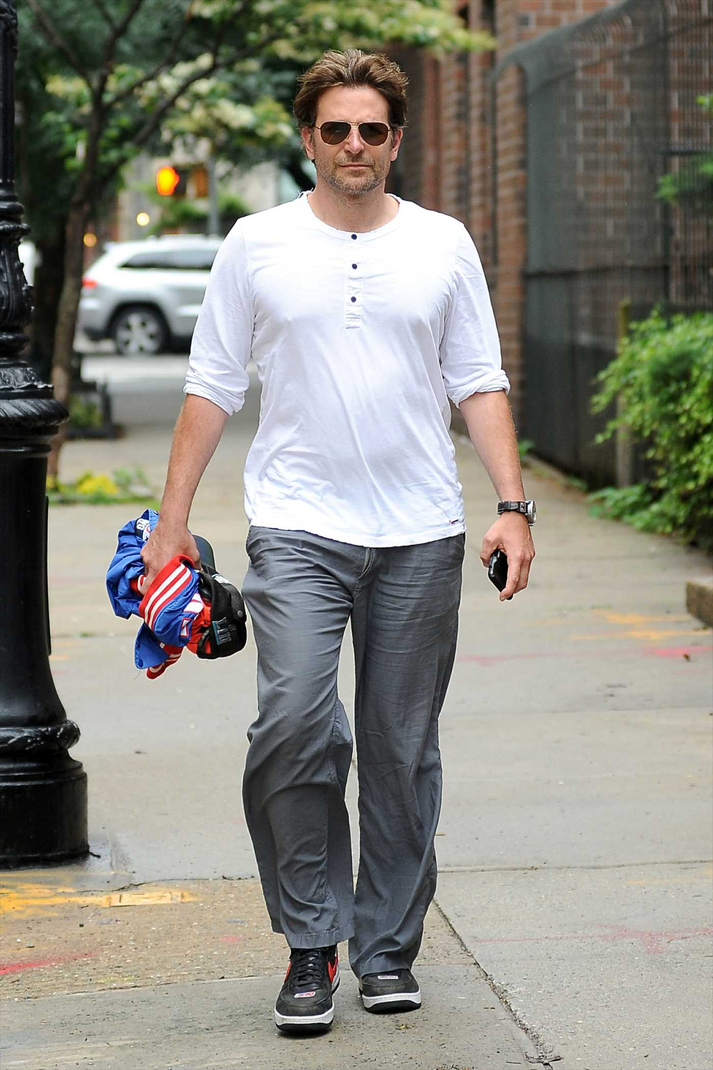Bradley Cooper in a White Long Sleeves T-Shirt Was Seen Out in New York 06/18/2019