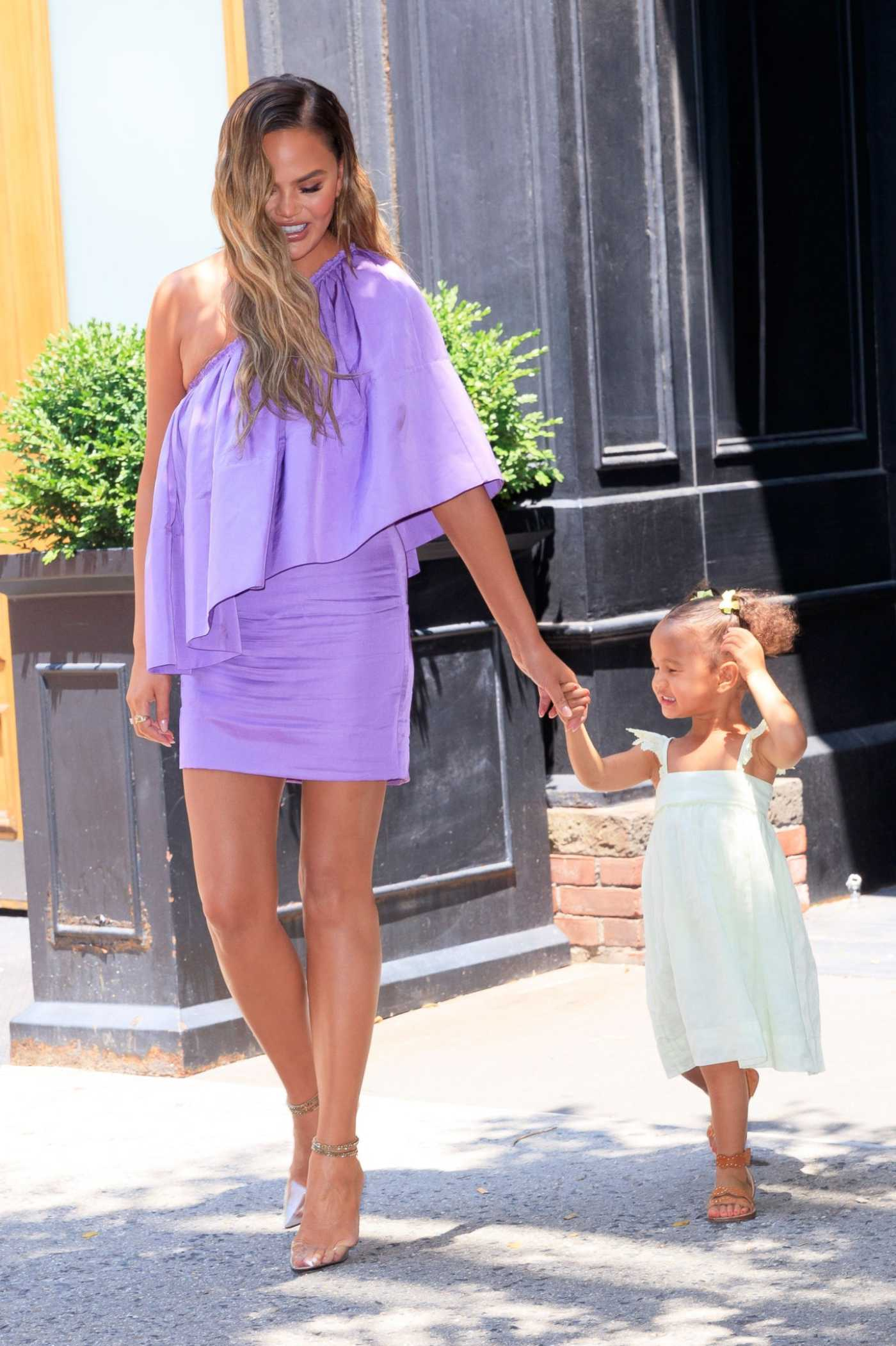 Chrissy Teigen in a Purple Dress Was Seen Out in New York City 06/23/2019
