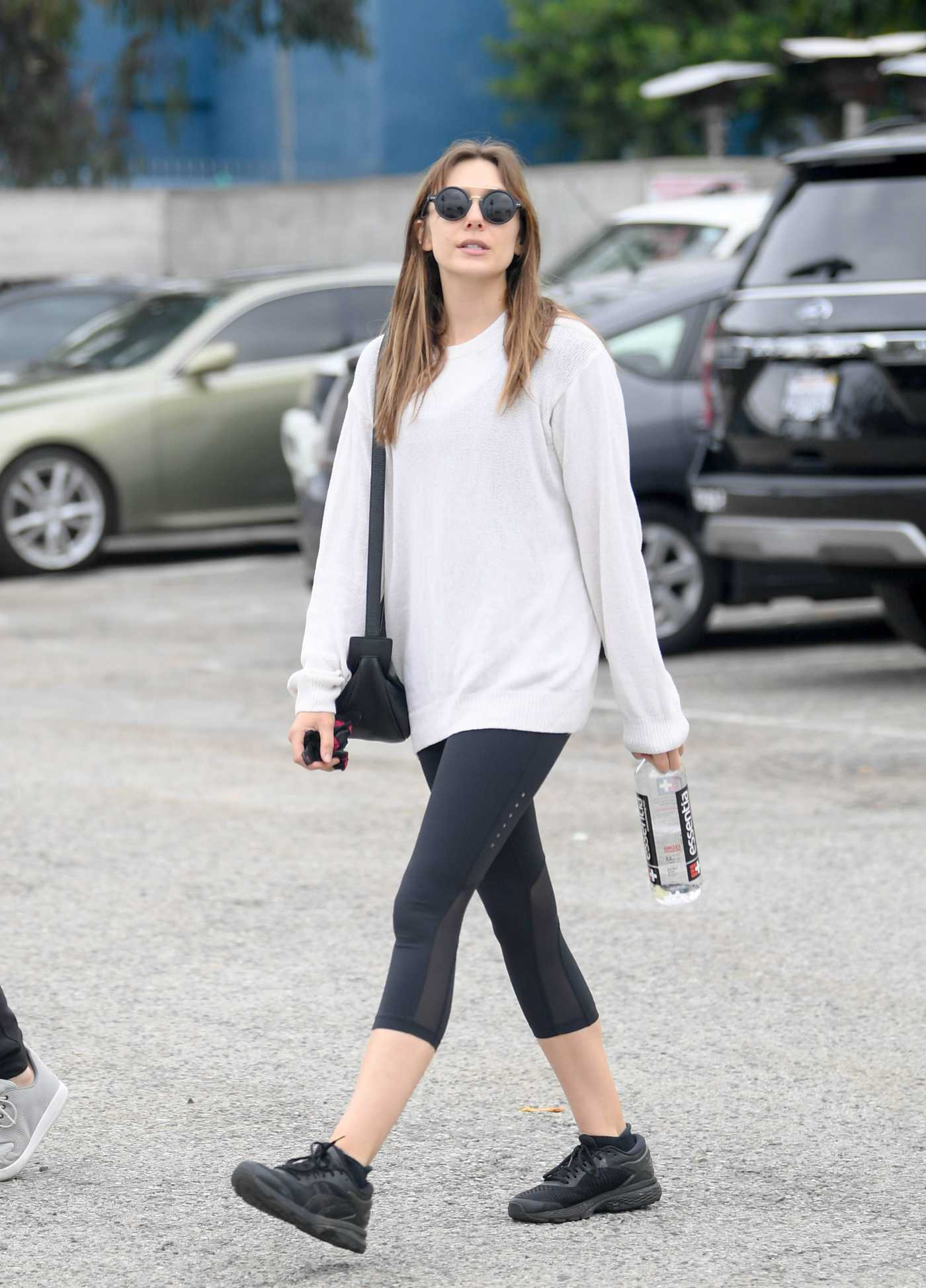 Elizabeth Olsen in a White Sweater Leaves the Gym in Los Angeles 06/03/2019