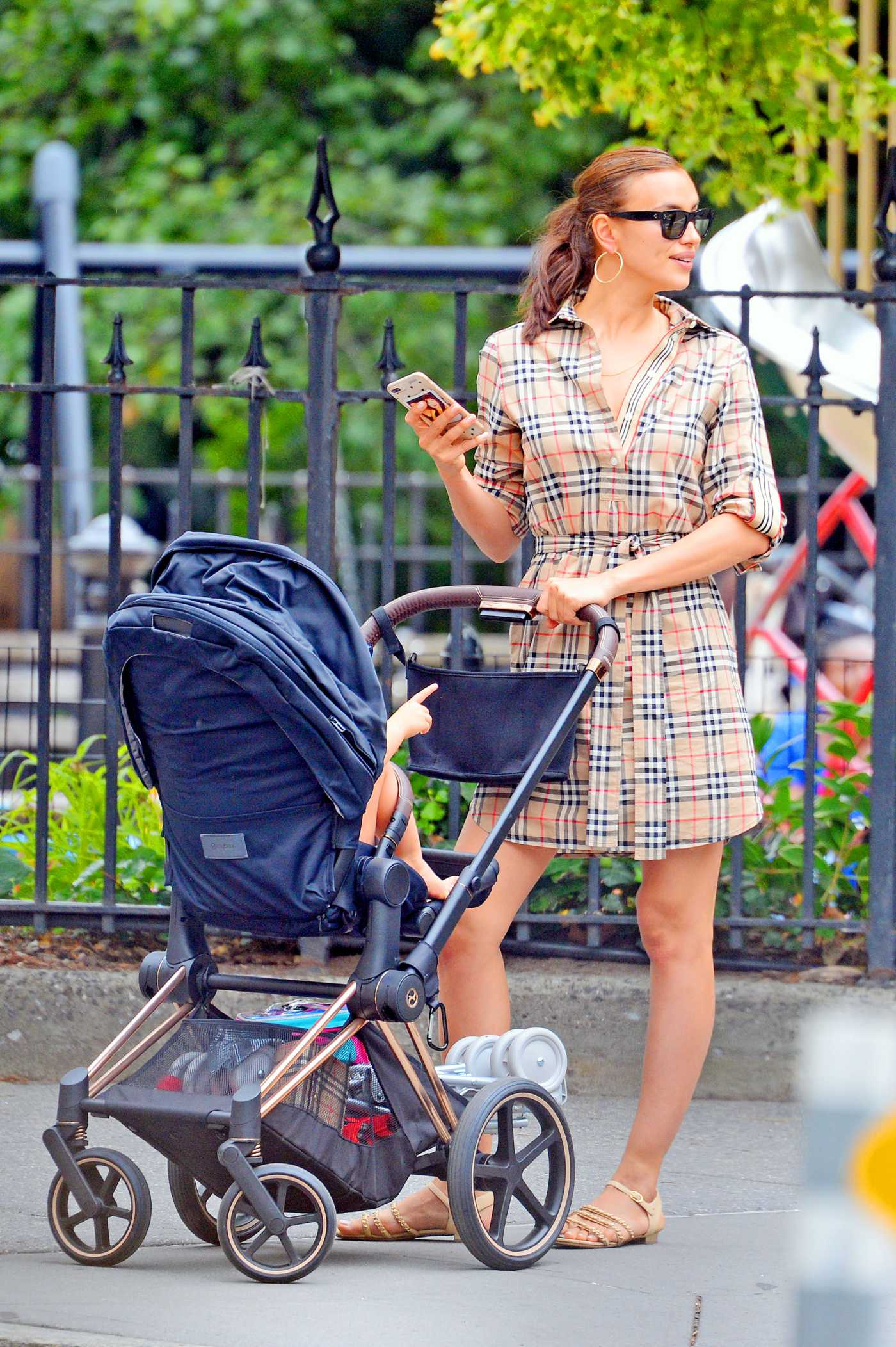 Irina Shayk in a Plaid Dress Was Seen with Her Daughter Lea in New York City 06/17/2019
