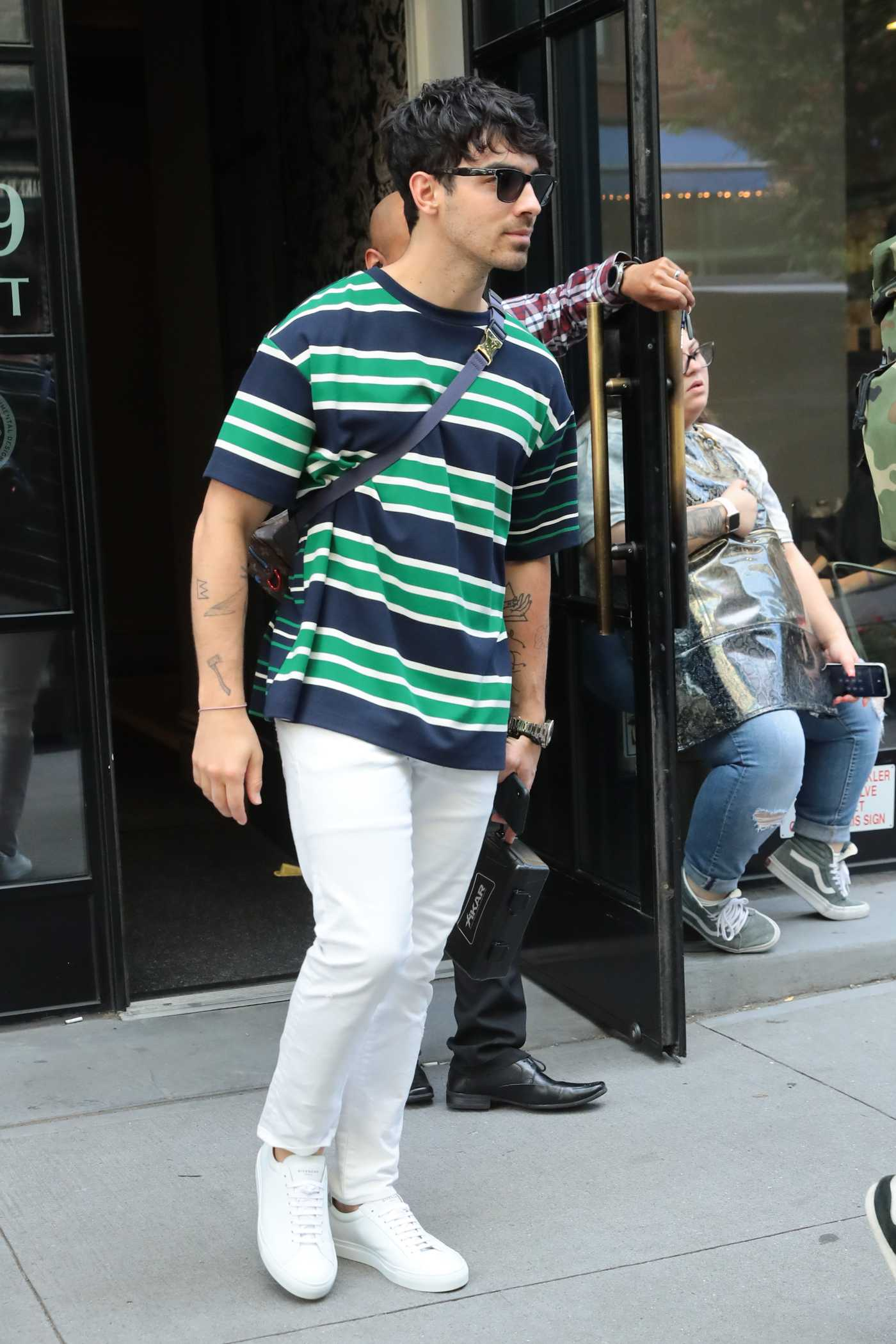 Joe Jonas in a White Pants Was Seen Out in New York 06/15/2019