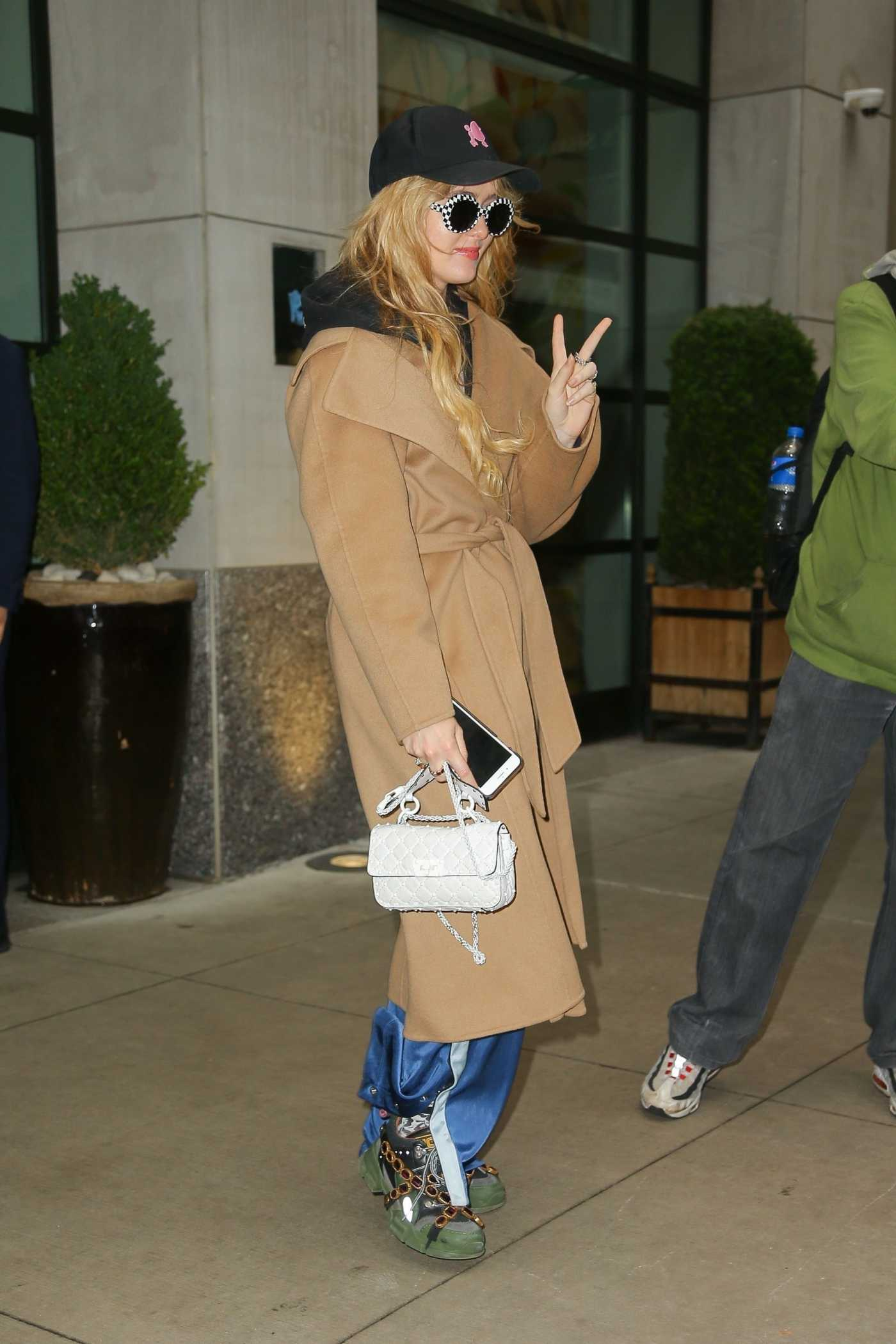 Kathryn Newton in a Beige Coat Was Seen Out in NYC 05/30/2019