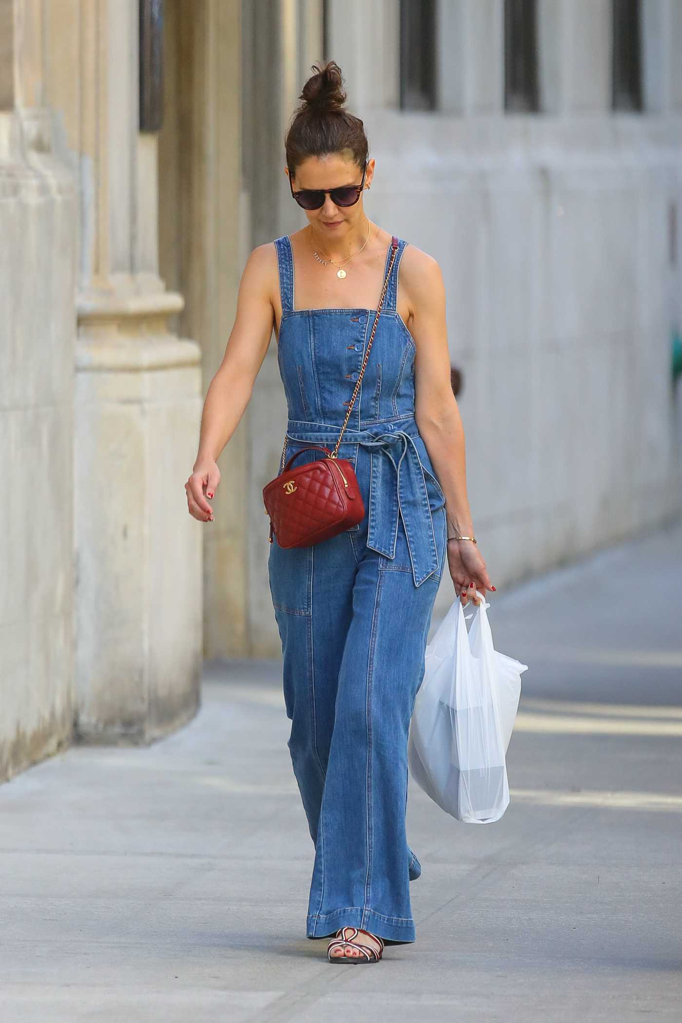 Katie Holmes in a Blue Denim Jumpsuit Goes Shopping in New York City 06/22/2019