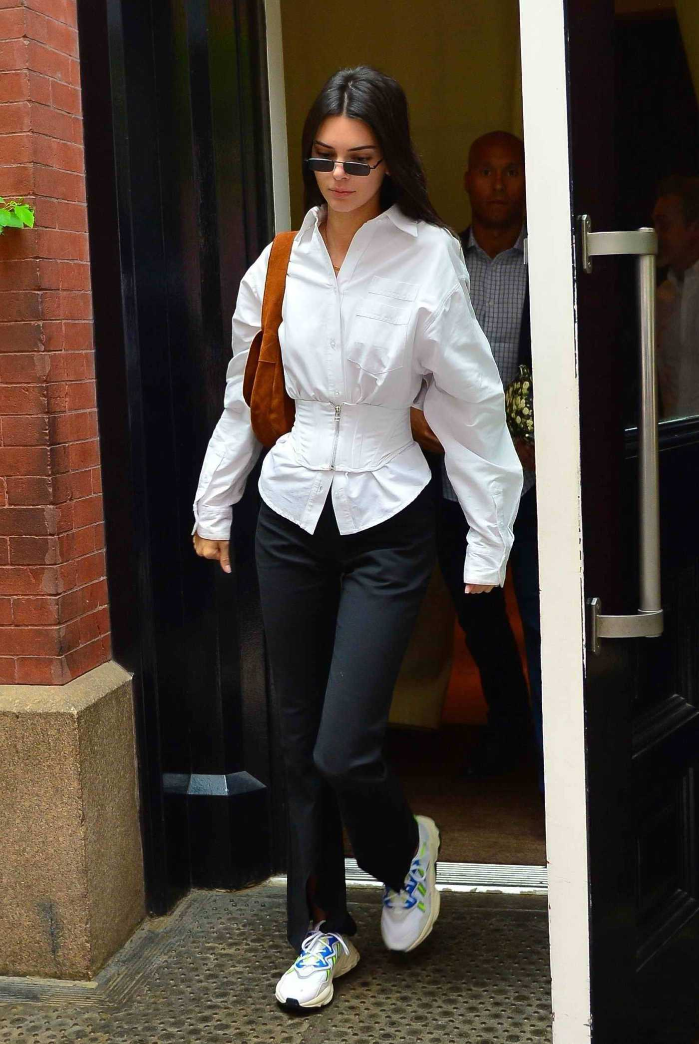 Kendall Jenner in a White Blouse Was Seen Out in NYC 05/31/2019