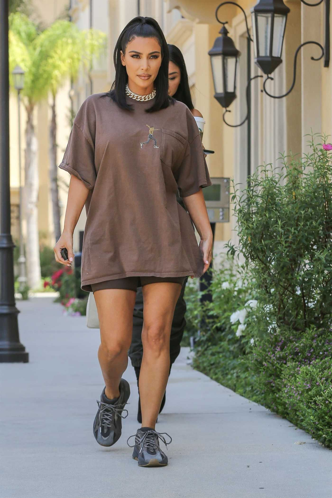 Kim Kardashian in a Brown Tee Leaves a Meeting in Calabasas 06/24/2019