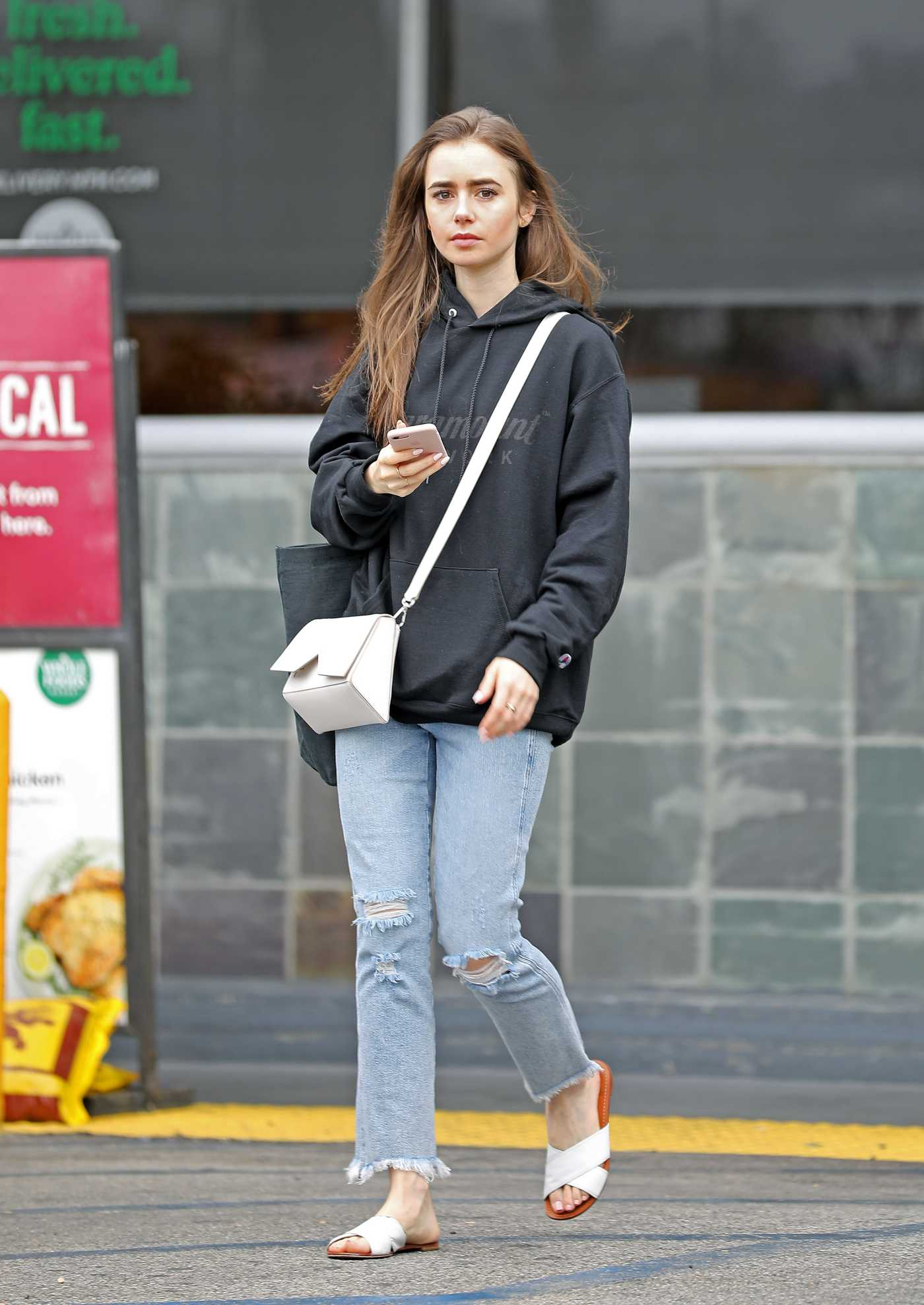 Lily Collins in a Black Hoody Was Seen Out in West Hollywood 06/16/2019