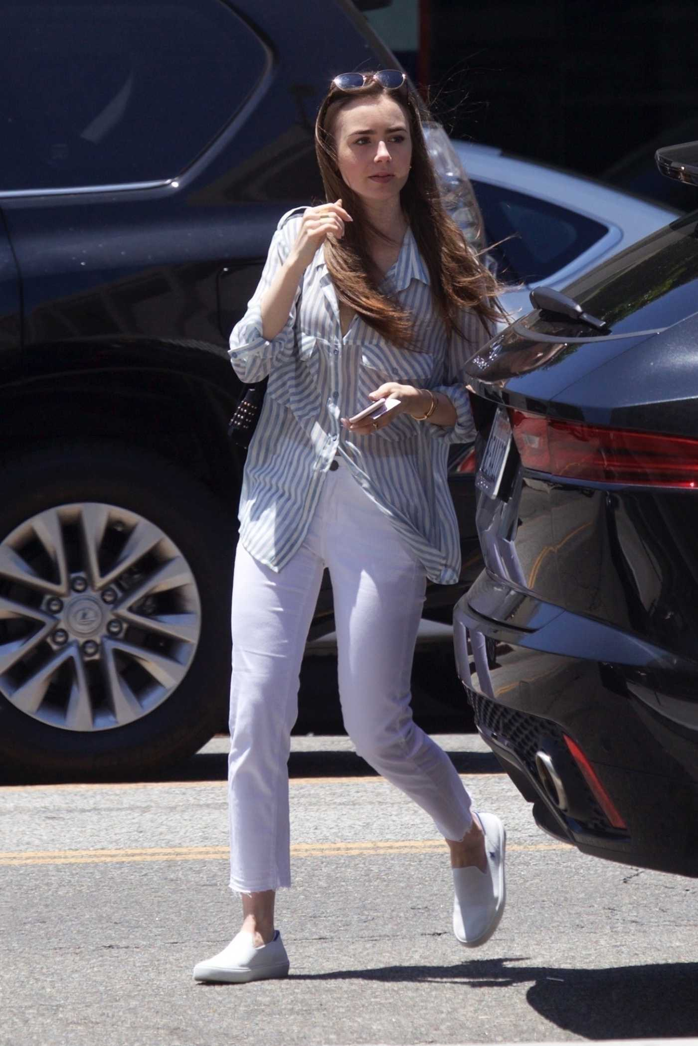 Lily Collins in a White Pants Was Seen Out in Beverly Hills 06/11/2019