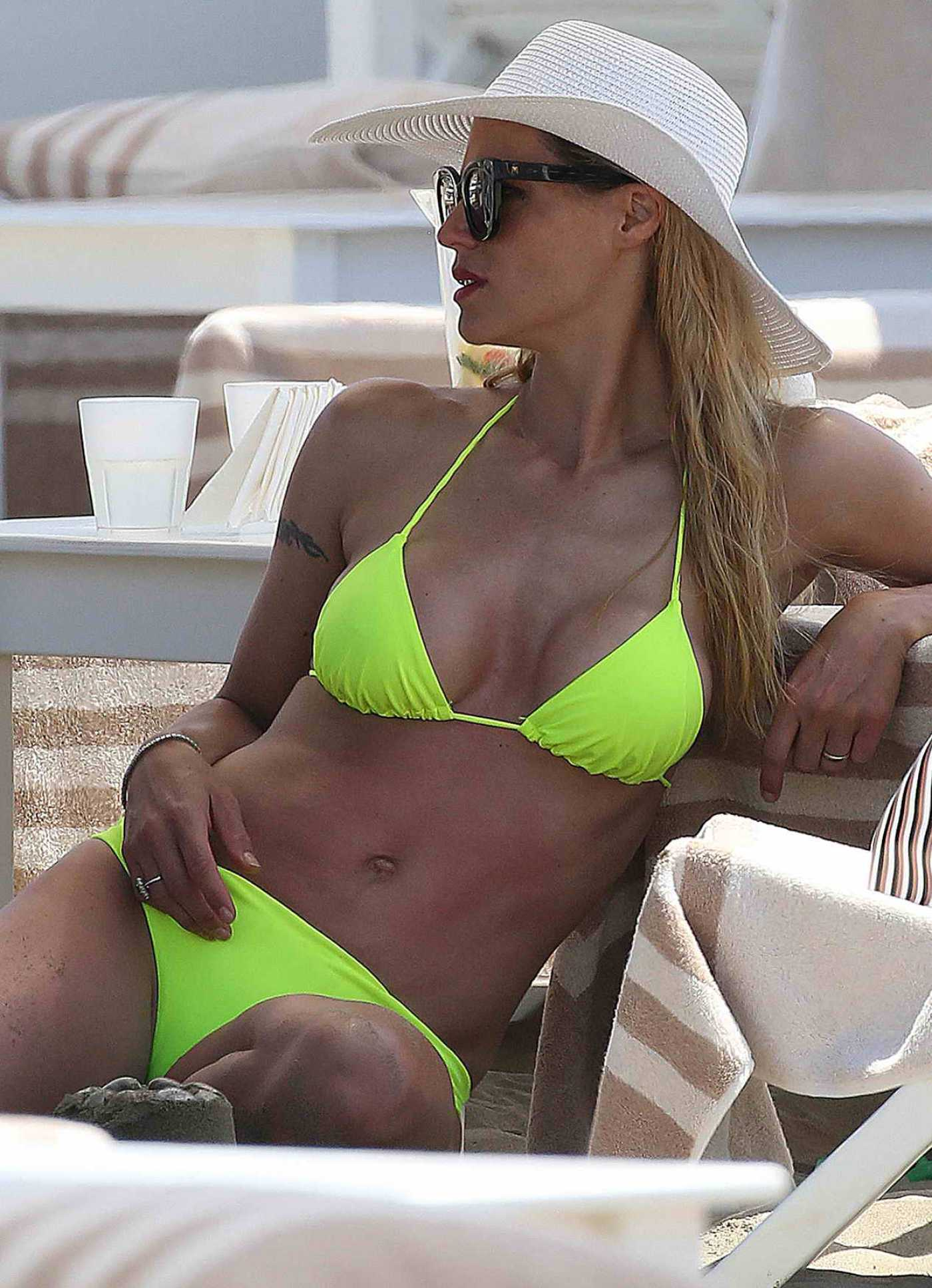 Michelle Hunziker in a Neon Green Bikini on the Beach in Forte dei Marmi 06/18/2019