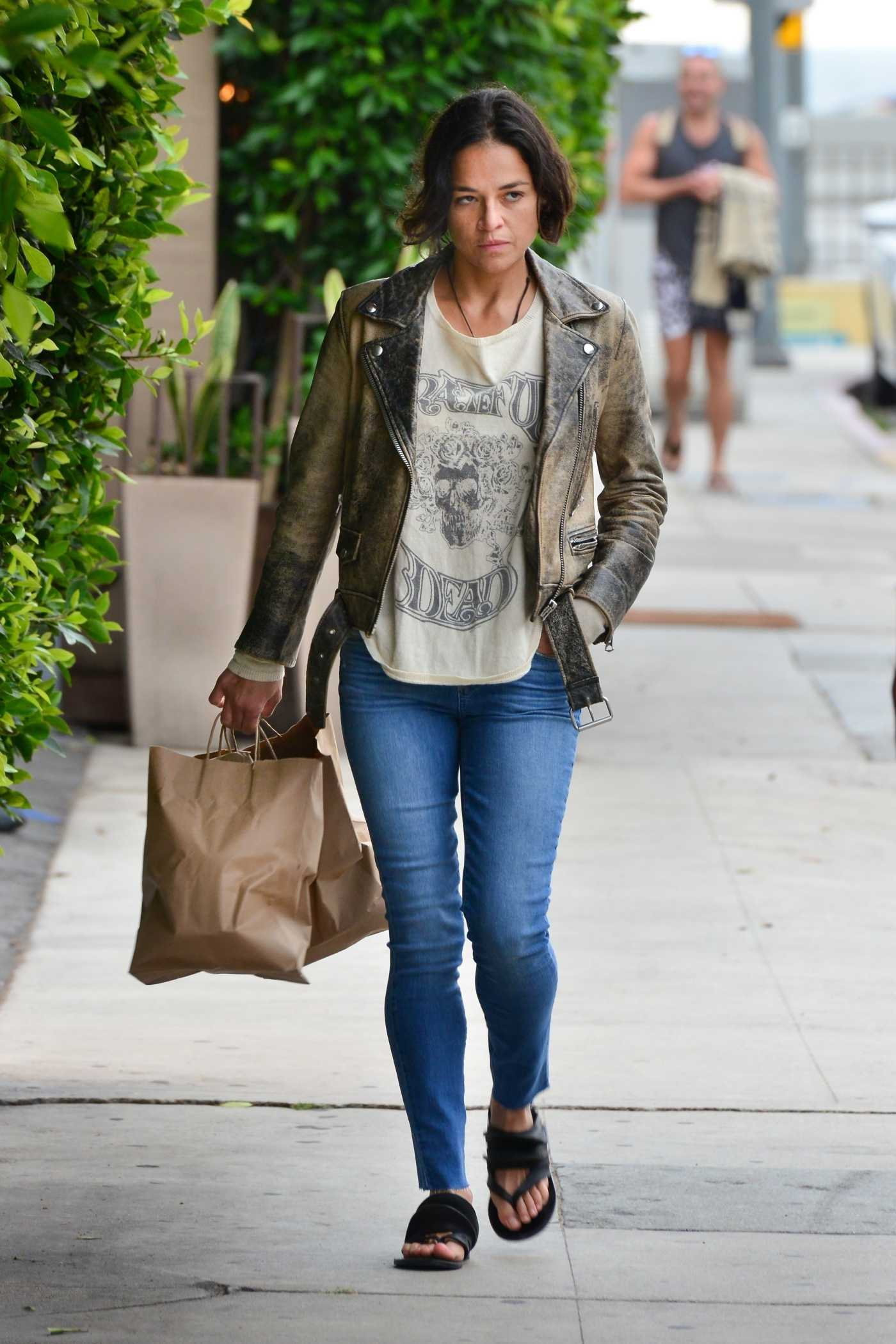 Michelle Rodriguez in a Blue Jeans Was Seen Out in Santa Monica 06/13/2019