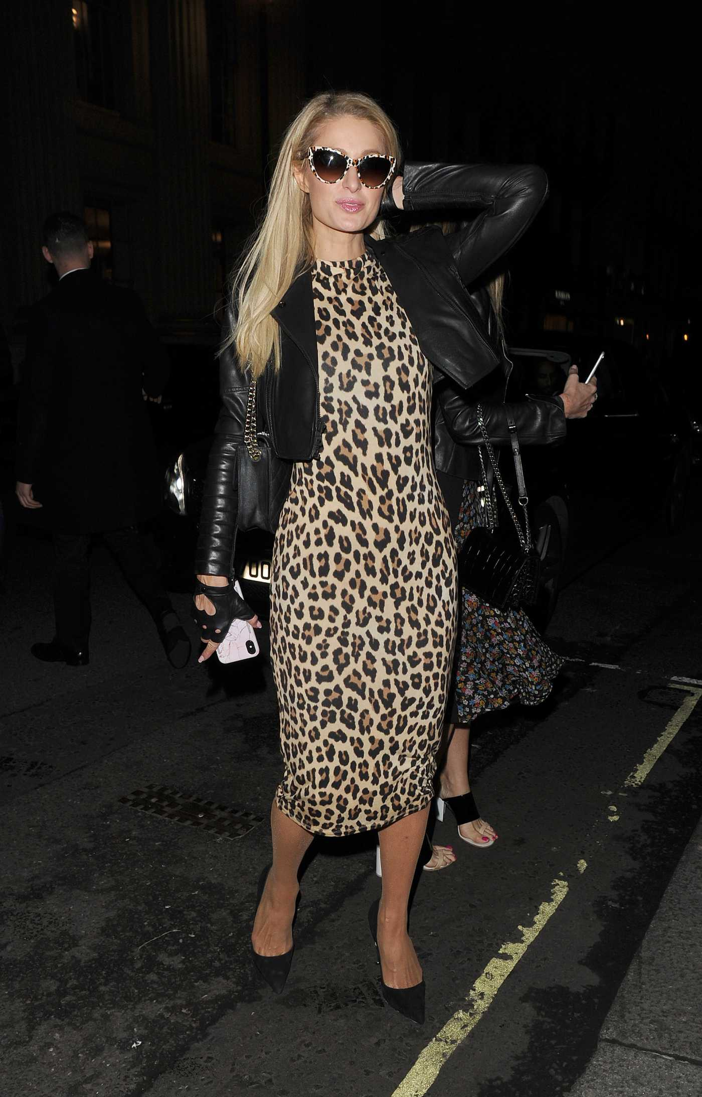 Paris Hilton in a Leopard Print Dress Arrives at Chiltern Firehouse in London 06/04/2019