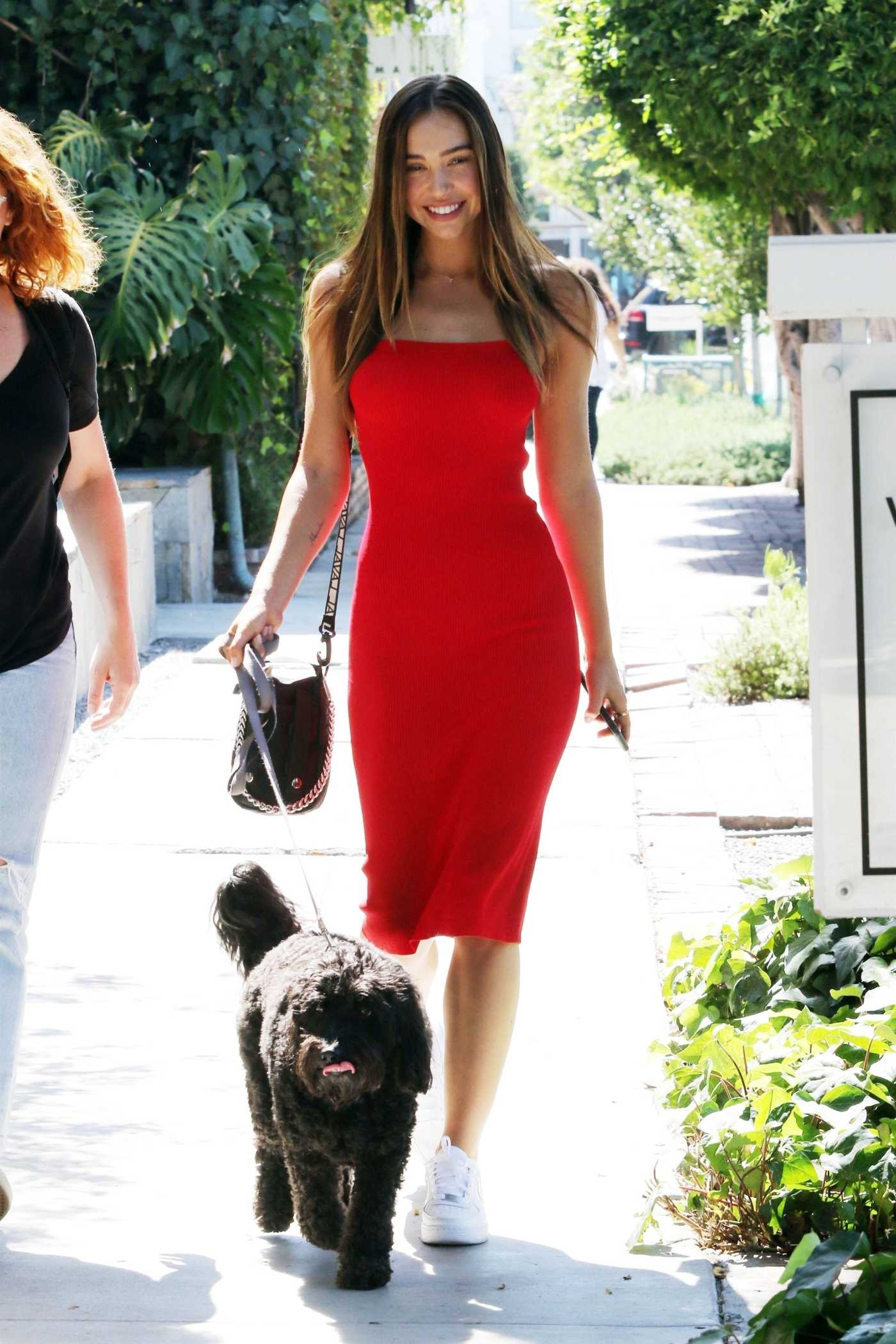 Alexis Ren in a Red Dress Walks Her Dog Out in West Hollywood 07/27/2019