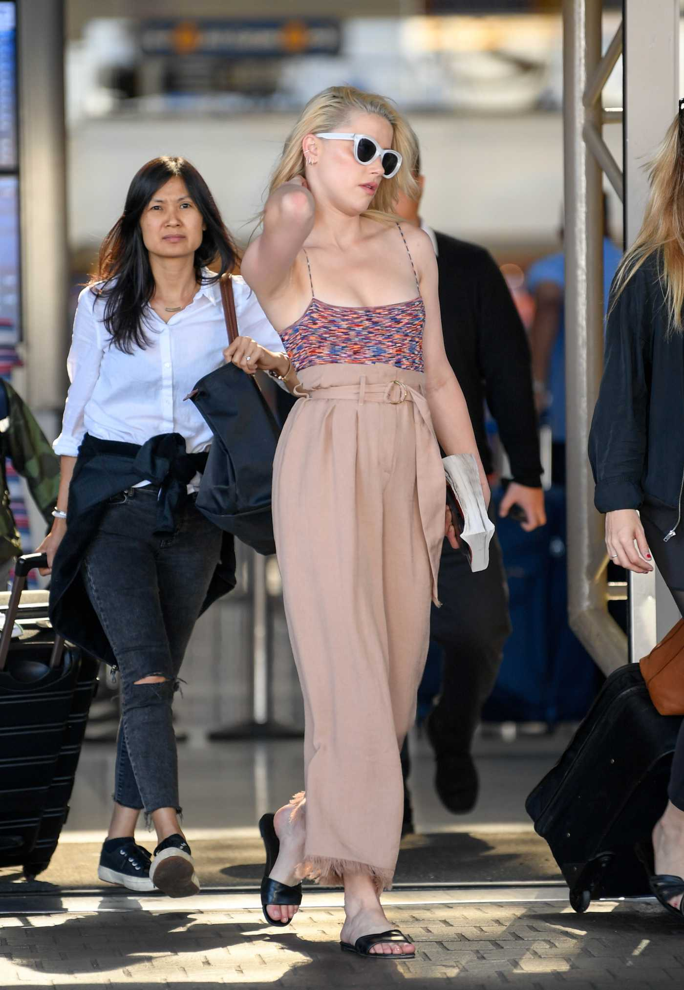 Amber Heard in a Beige Pants Arrives at LAX Airport in Los Angeles 07/05/2019